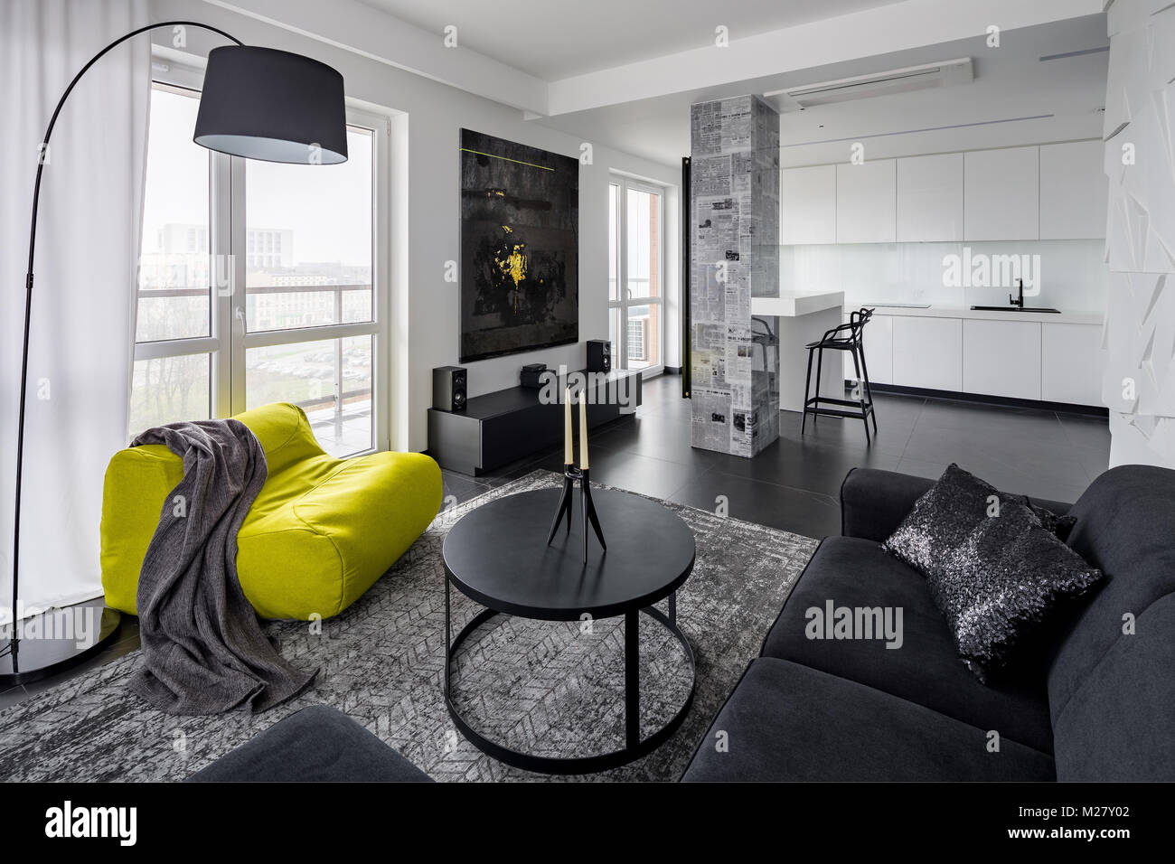 Black and white modern living room with green sack chair Stock Photo