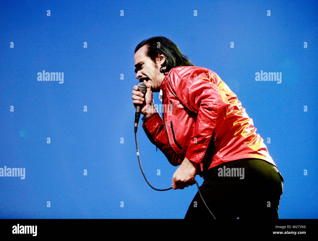 The alternative rock band Grinderman is here pictured with lead singer Nick Cave live on stage at a gig at Roskilde - Stock Image