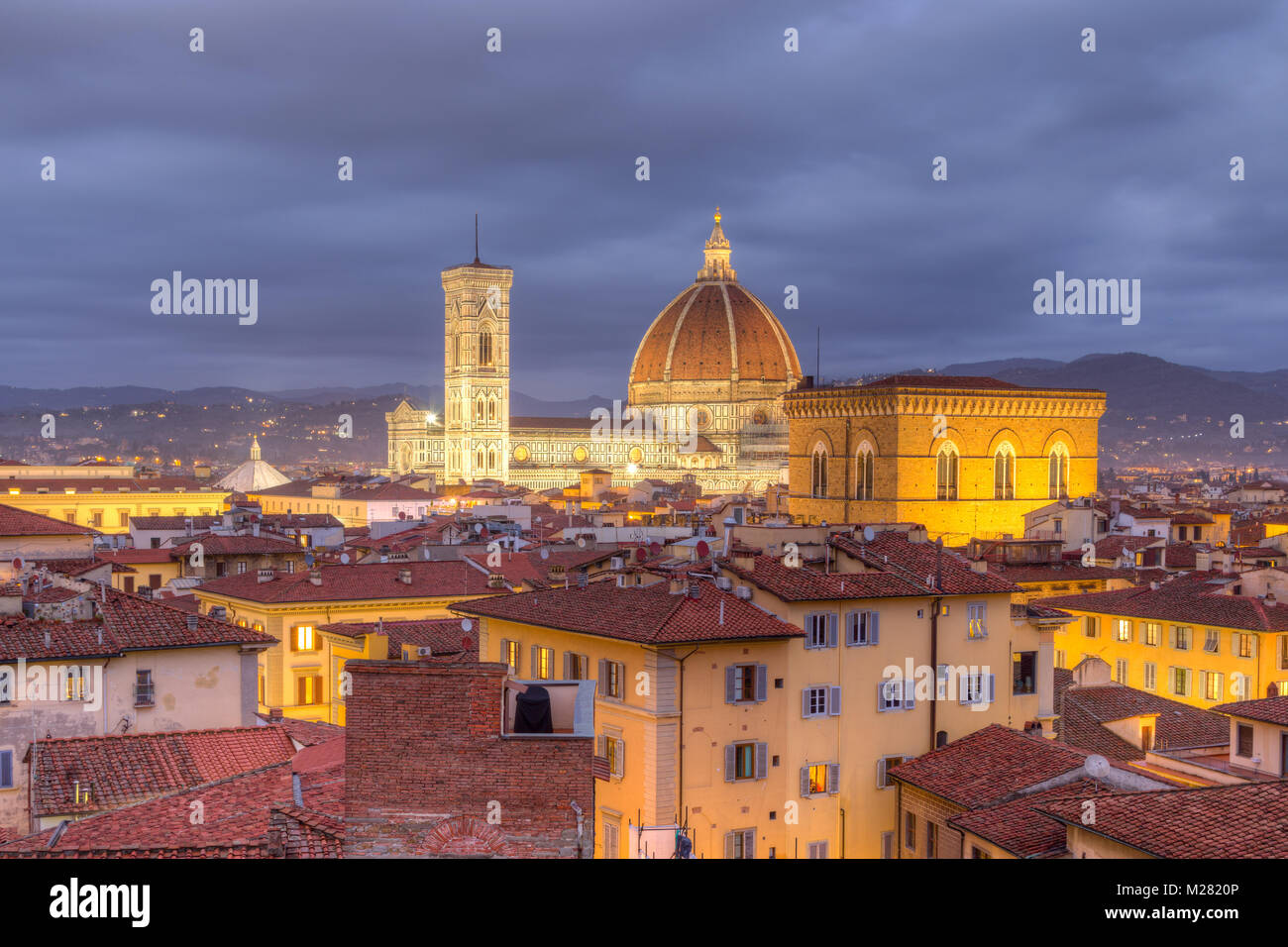View over Florence with Cathedral Duomo Santa Maria del Fiore and church Orsanmichele at dusk, Florence, Tuscany, - Stock Image