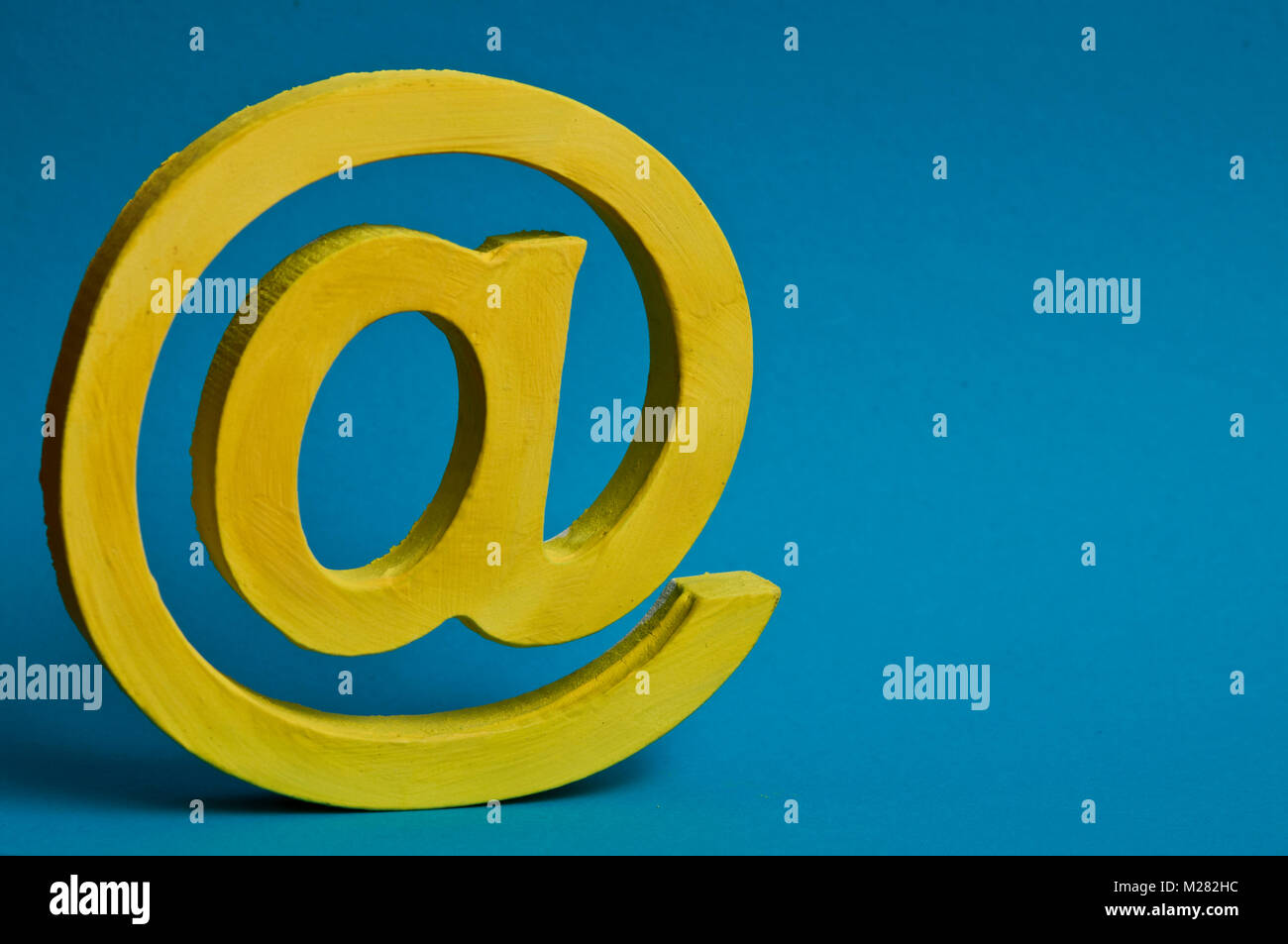 @ sign for email, yellow on blue - Stock Image