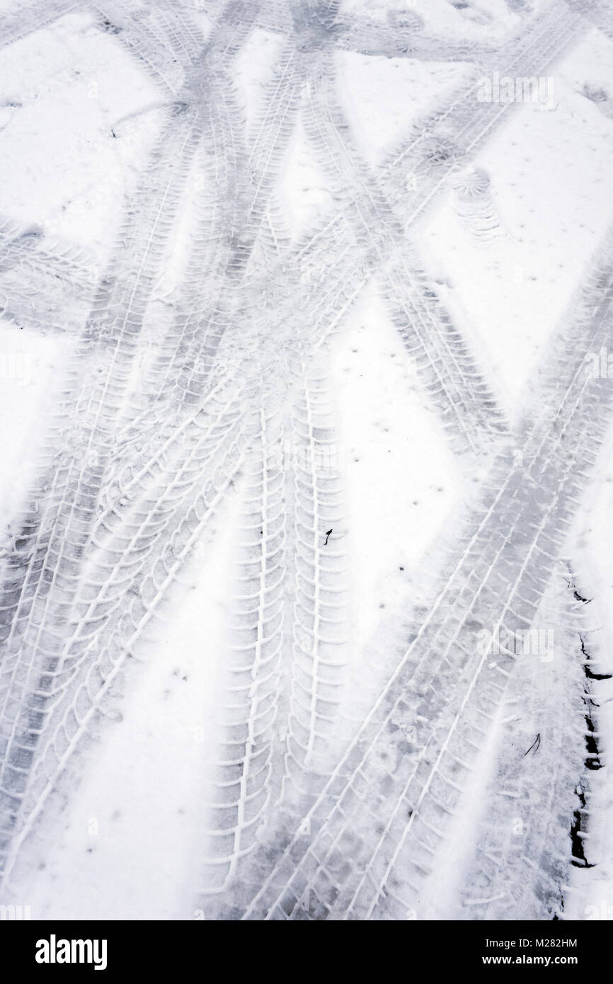 tire tracks on snow - Stock Image