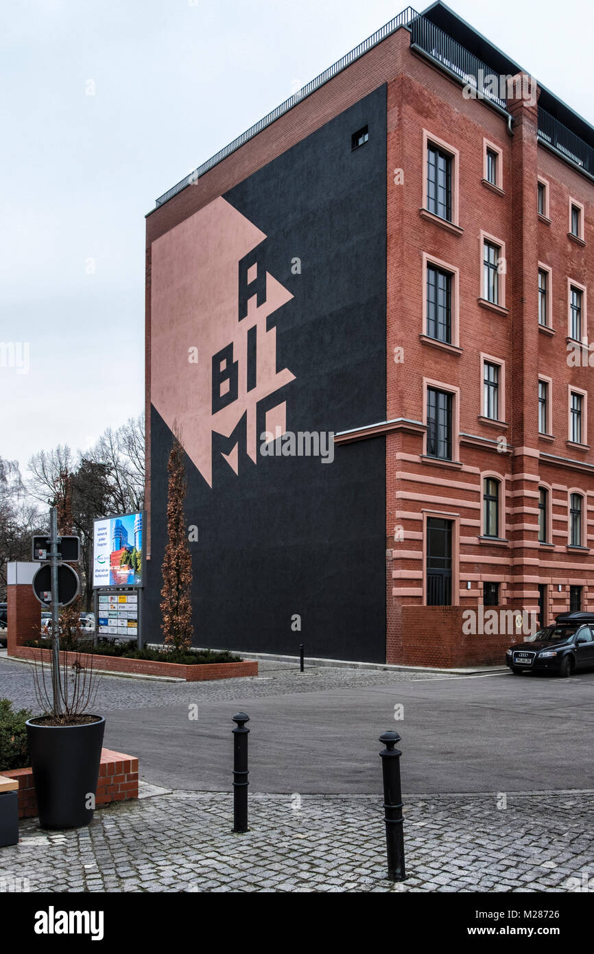 Berlin,Mitte,Moabit.Clever wall art on apartment building,face withh letters spelling MOABIT - Stock Image