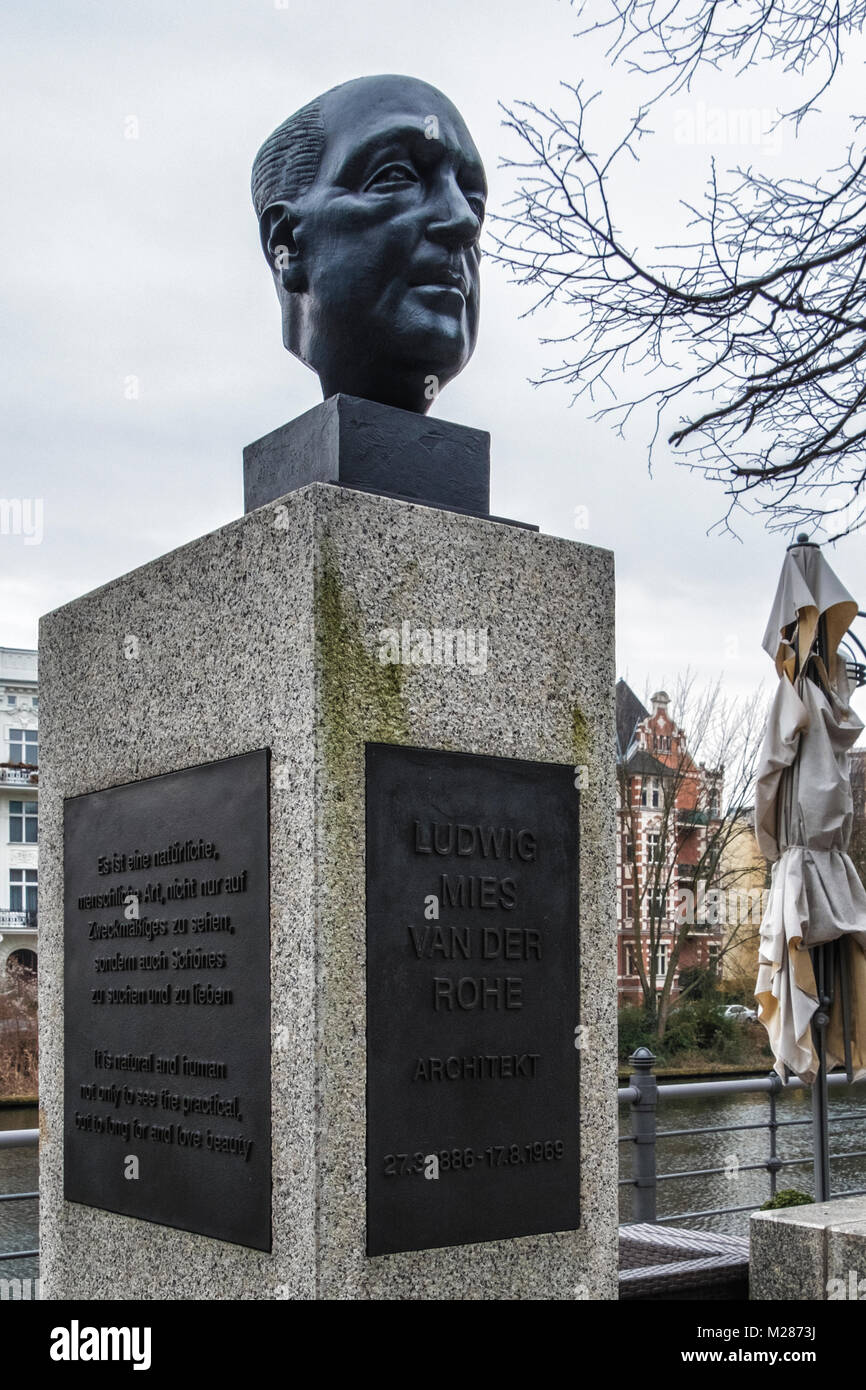 Berlin,Mitte,Moabit.Bronze bust of Architect Ludwig Mies van der Rohe on the Street of Remembrance next to River - Stock Image