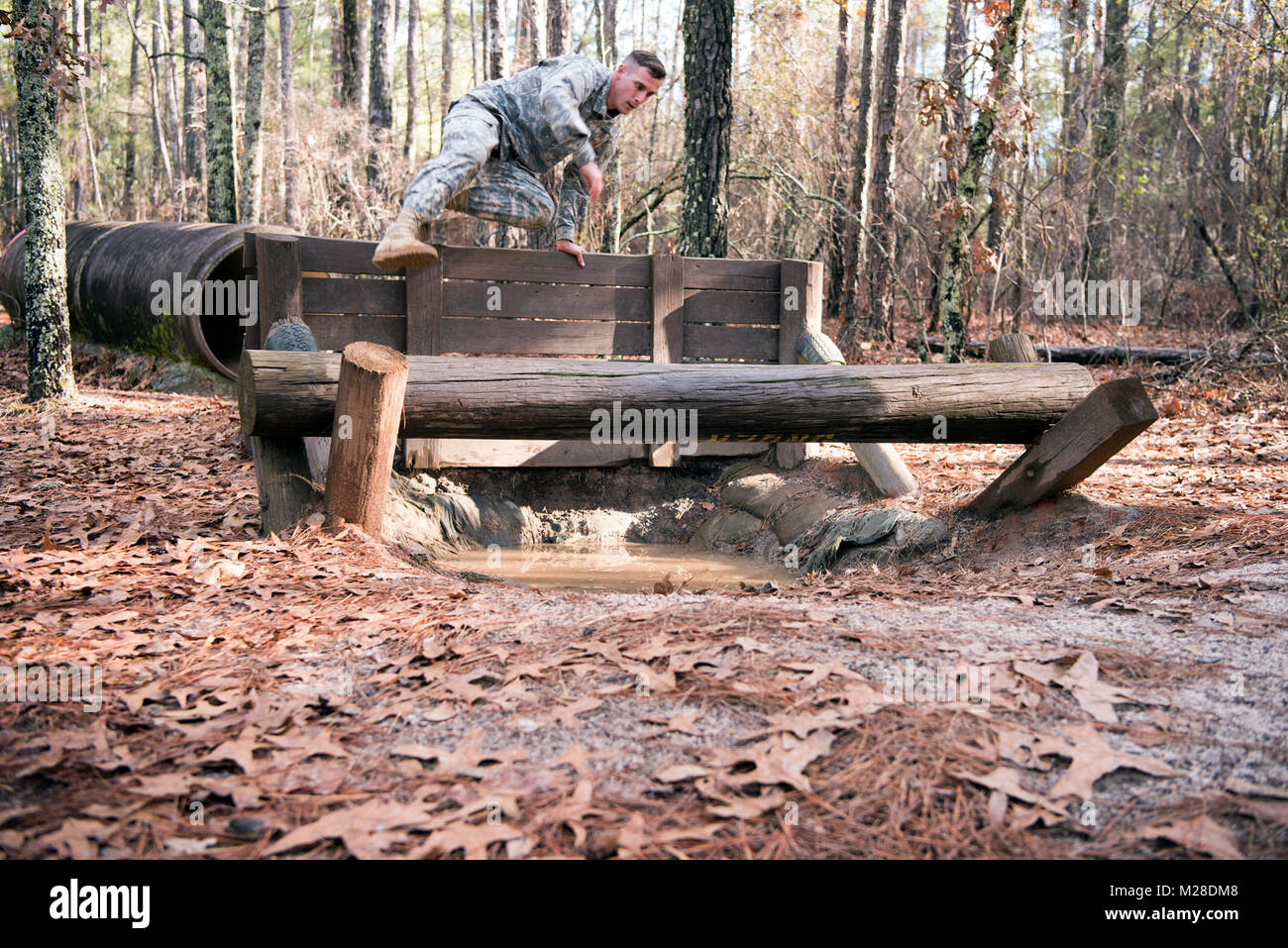 Sgt. Jake Chupp, bridge crew member, 125th Multi Role Bridge Company, vaults an obstacle during the South Carolina Stock Photo