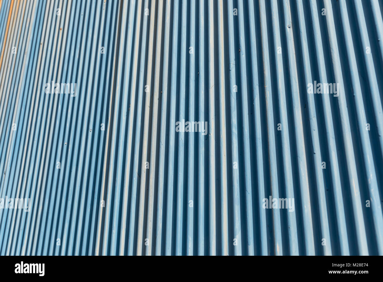 Blue corrugated metal wall - Stock Image