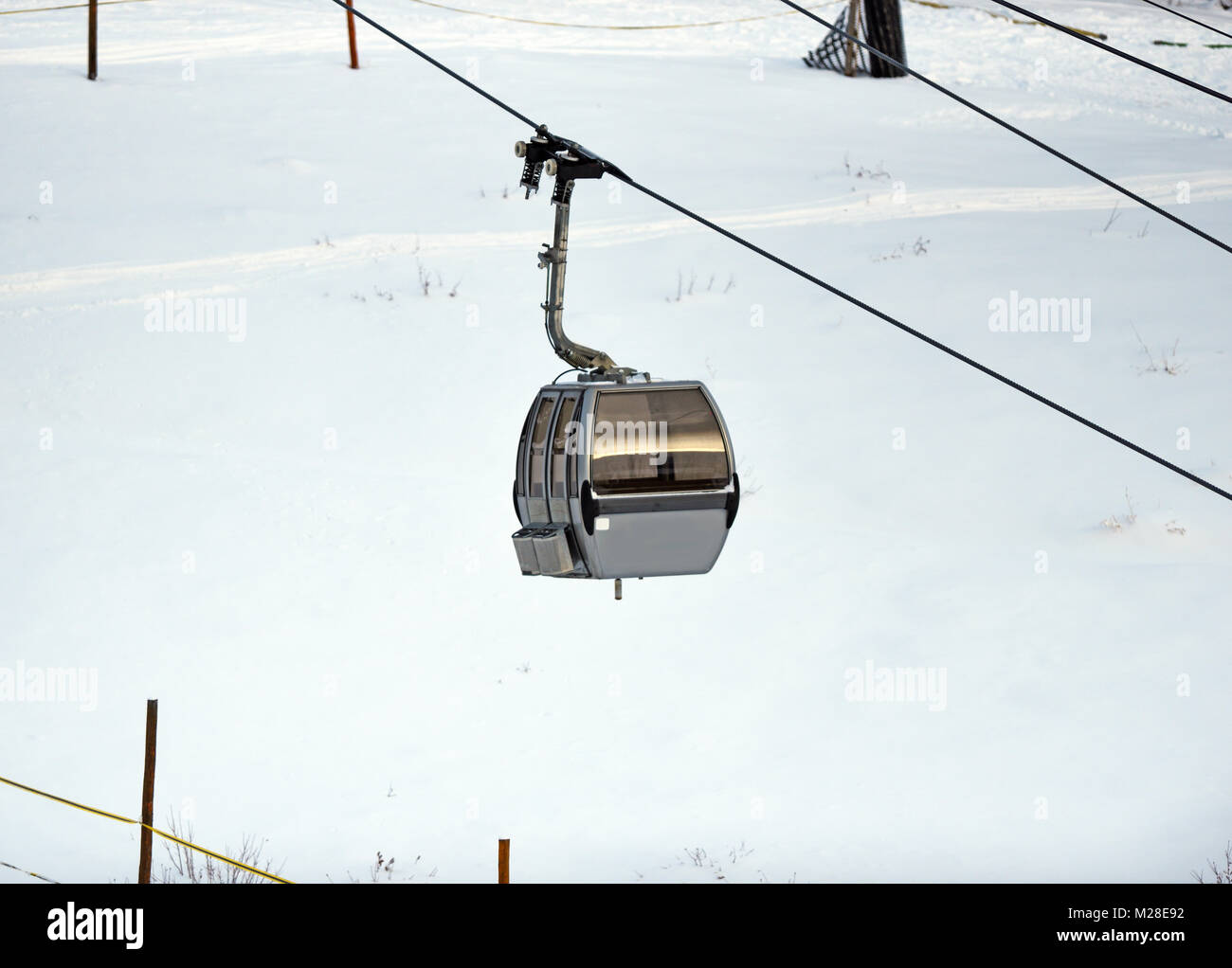Gondola at ski resort with white snow in winter - Stock Image