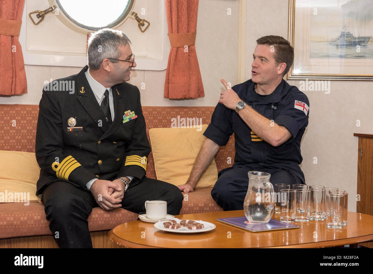 CONSTANTA, Romania, Feb 1. 2018 SNMCMG2 Commander, Justin Hains speaks with leadership from the Romanian Navy Hydrographic Stock Photo