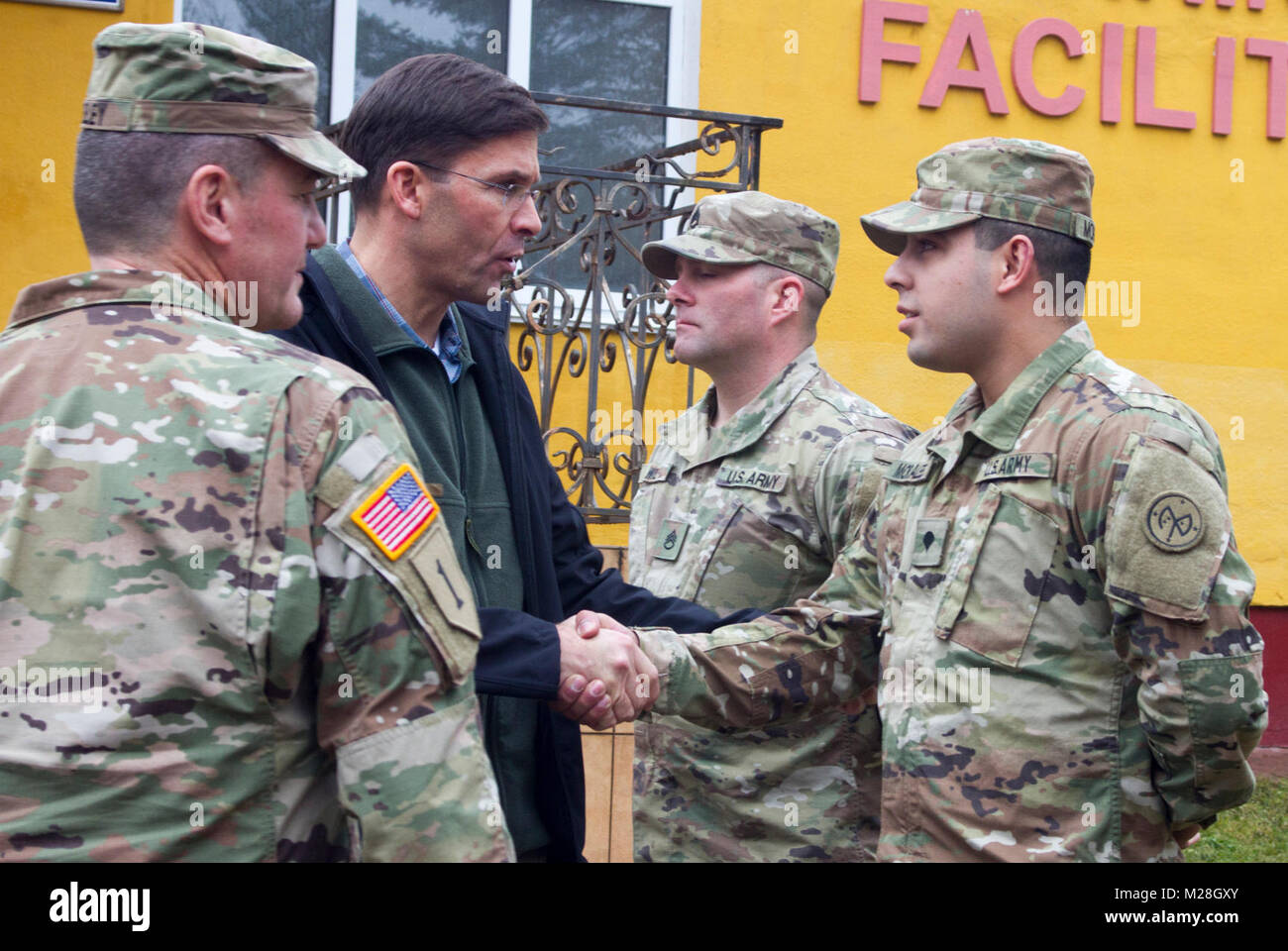 Yavoriv, Ukraine – Mark T. Esper, the United States Secretary of the Army presents a challenge coin to Spc. Kevin Morales, a motor transport operator assigned to the Joint Multinational Training Group – Ukraine during a visit to the Yavoriv Combat Training Center here Feb. 2. Currently more than 220 Soldiers from New York's 27th Infantry Brigade Combat Team are deployed to Ukraine where they are working hand-in-hand with the Ukrainian Army as they strive toward obtaining its goal of NATO interoperability. (U.S. Army Stock Photo