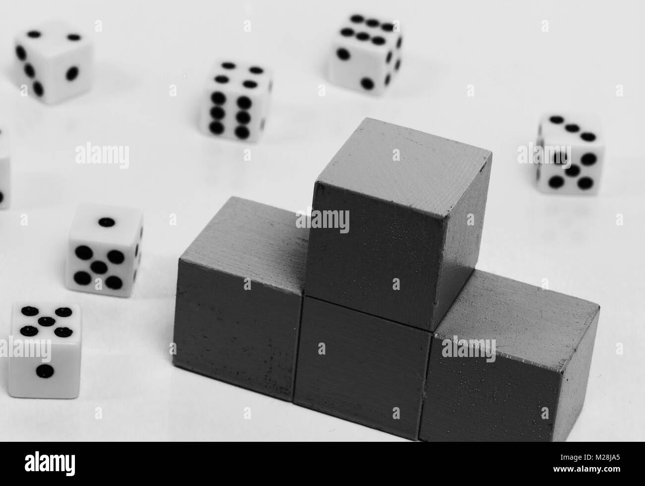 podium surrounded by dice as a symbol of luck - Stock Image