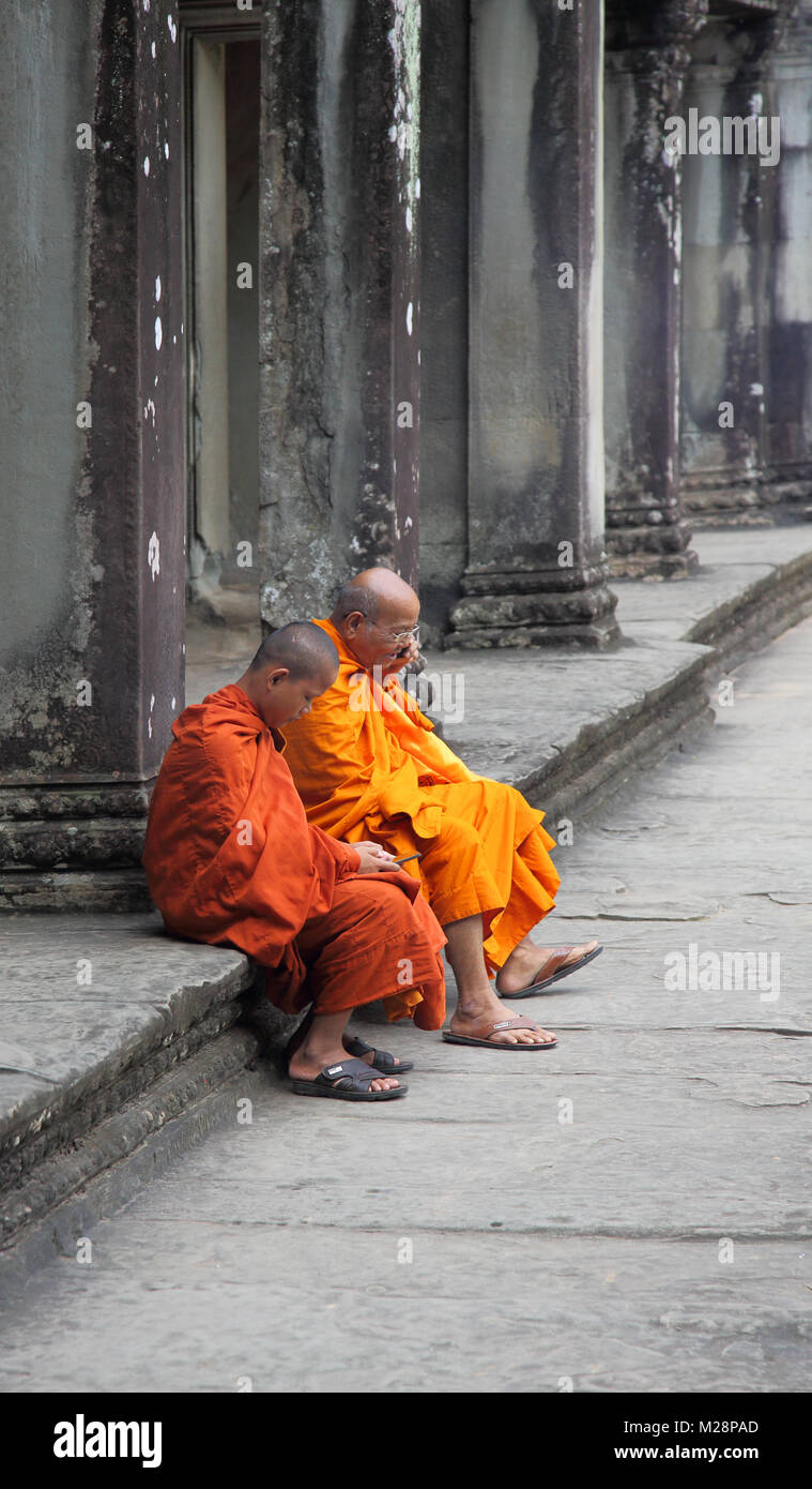 buddhist monks at the ancient temple of angkor wat at siem reap cambodia - Stock Image