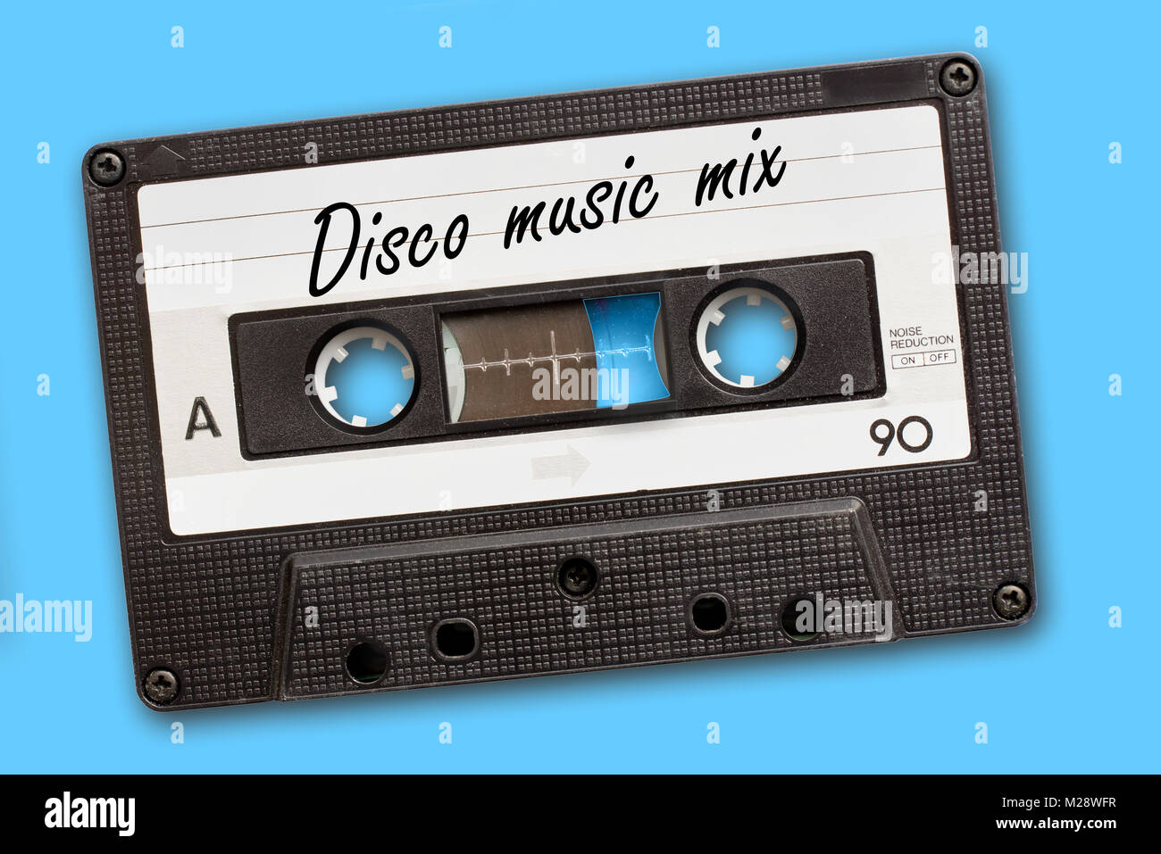 Disco music mix written on vintage audio cassette tape, blue background - Stock Image