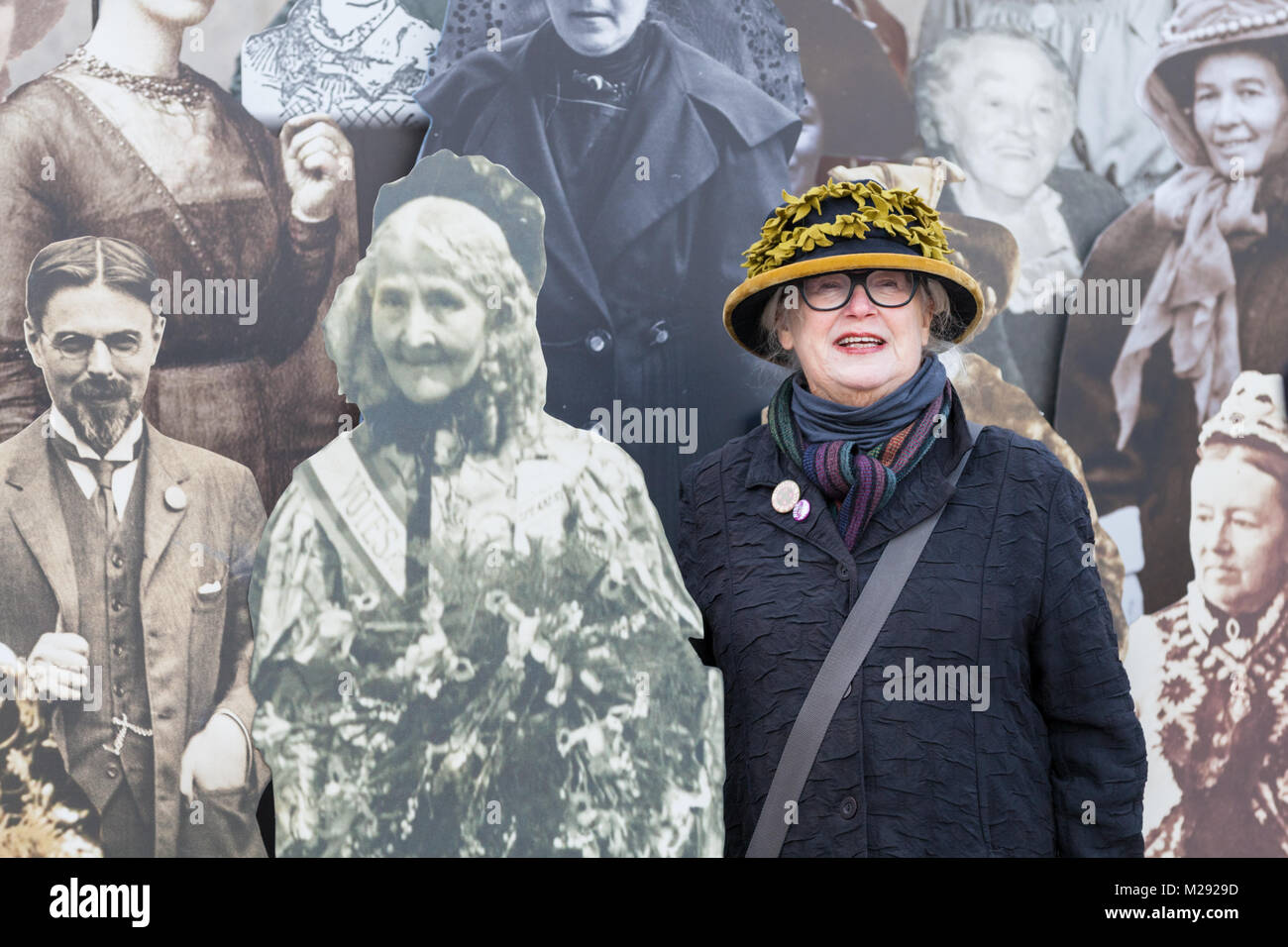 Trafalgar Square, London, 6th Feb 2018. A woman in a Suffragette's hat has travelled all the way from New Zealand - Stock Image