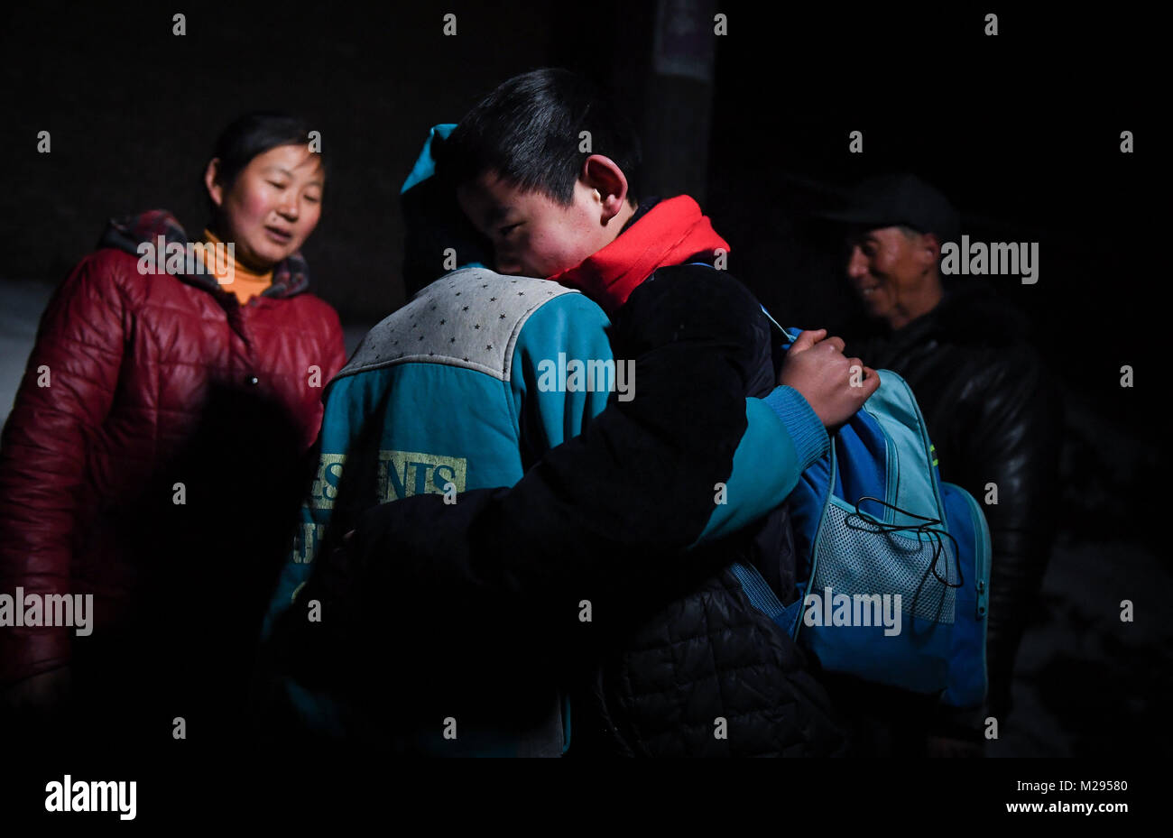 (180206) -- KANGLE, Feb. 6, 2018 (Xinhua) -- Sun Jianjun (R) hugs with his younger brother Sun Jianqiang at home - Stock Image