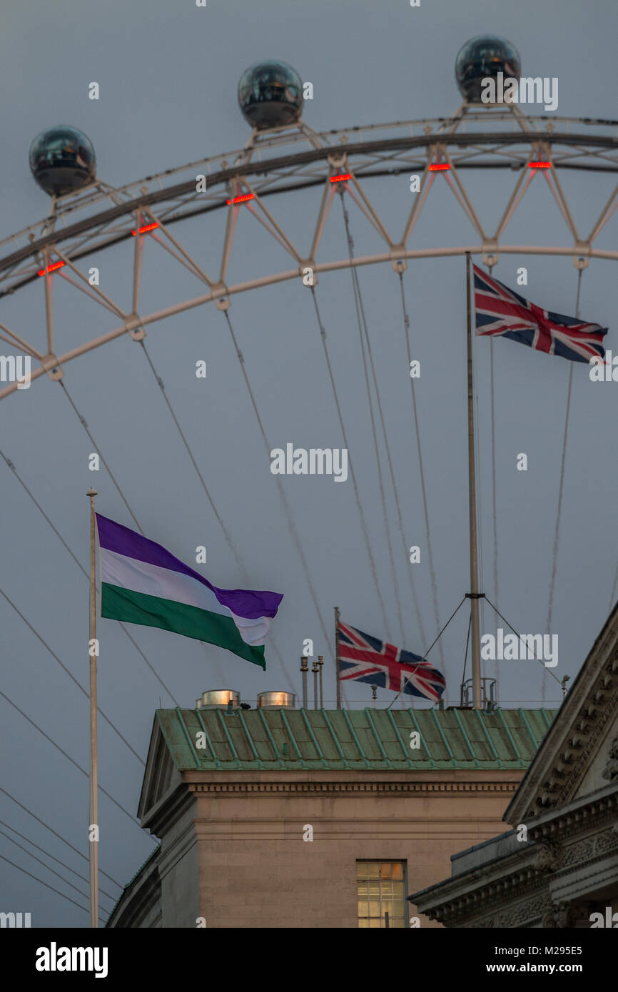 London, UK. 6th Feb, 2018. The Suffrage flag flies over Whitehall at the back of Downing Street. It coincides with - Stock Image
