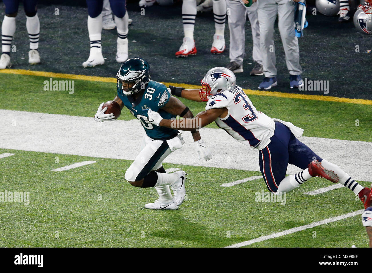 February 04, 2018 Philadelphia Eagles running back Corey Clement (30) carries the ball and breaks a tackle during - Stock Image
