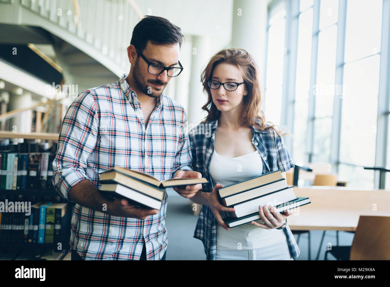 Young woman and man studying for an exam - Stock Image