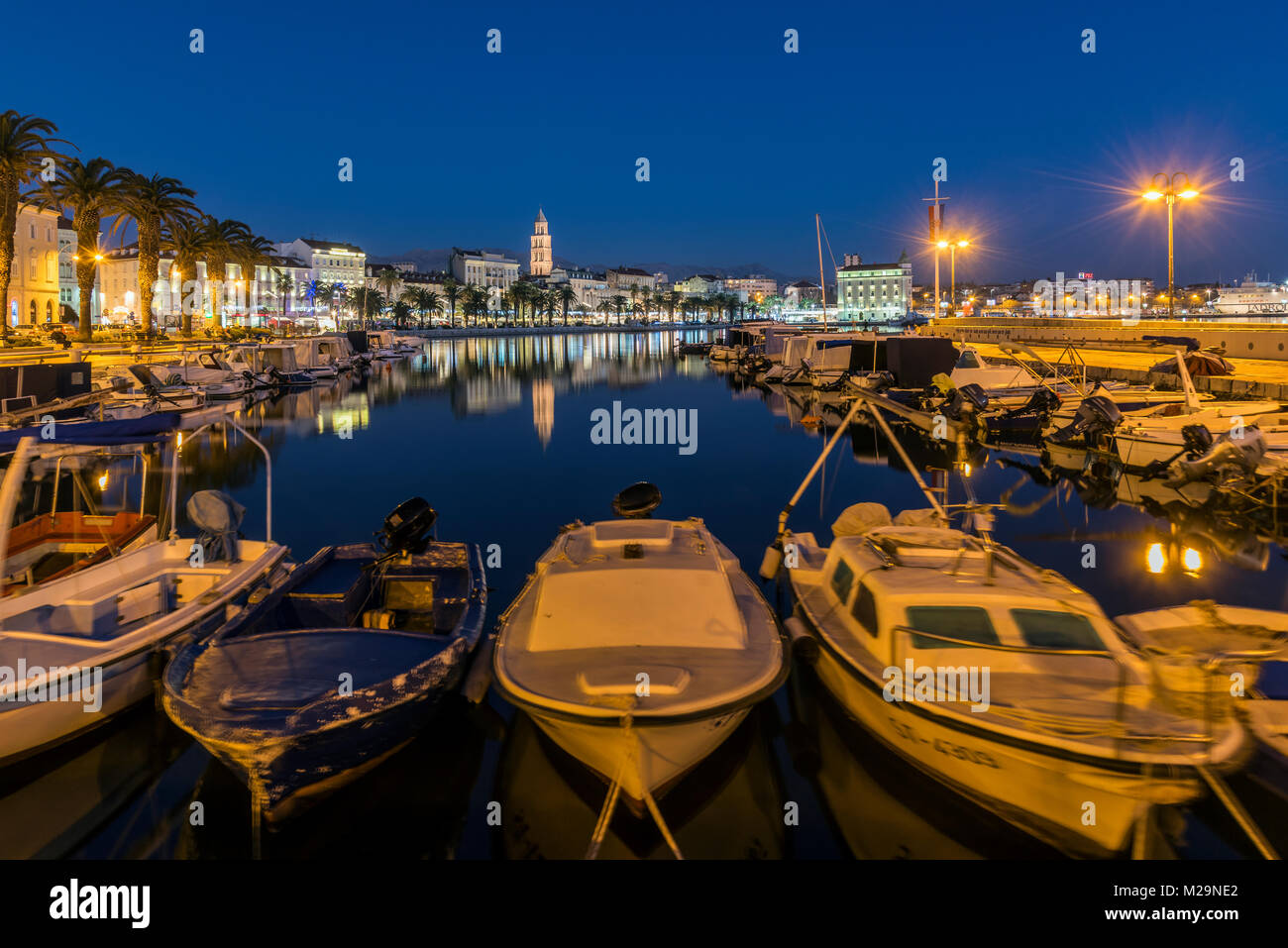 Waterfront and port with Cathedral of St. Domnius in the background, Split, Dalmatia, Croatia - Stock Image