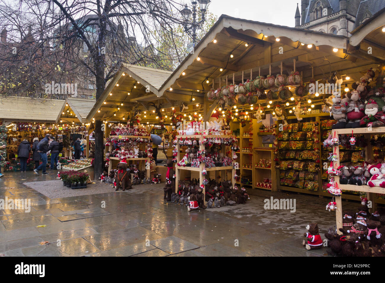 Before the Manchester Christmas market rush: Manchester Christmas market in Albert Square, very quiet on a wet late - Stock Image
