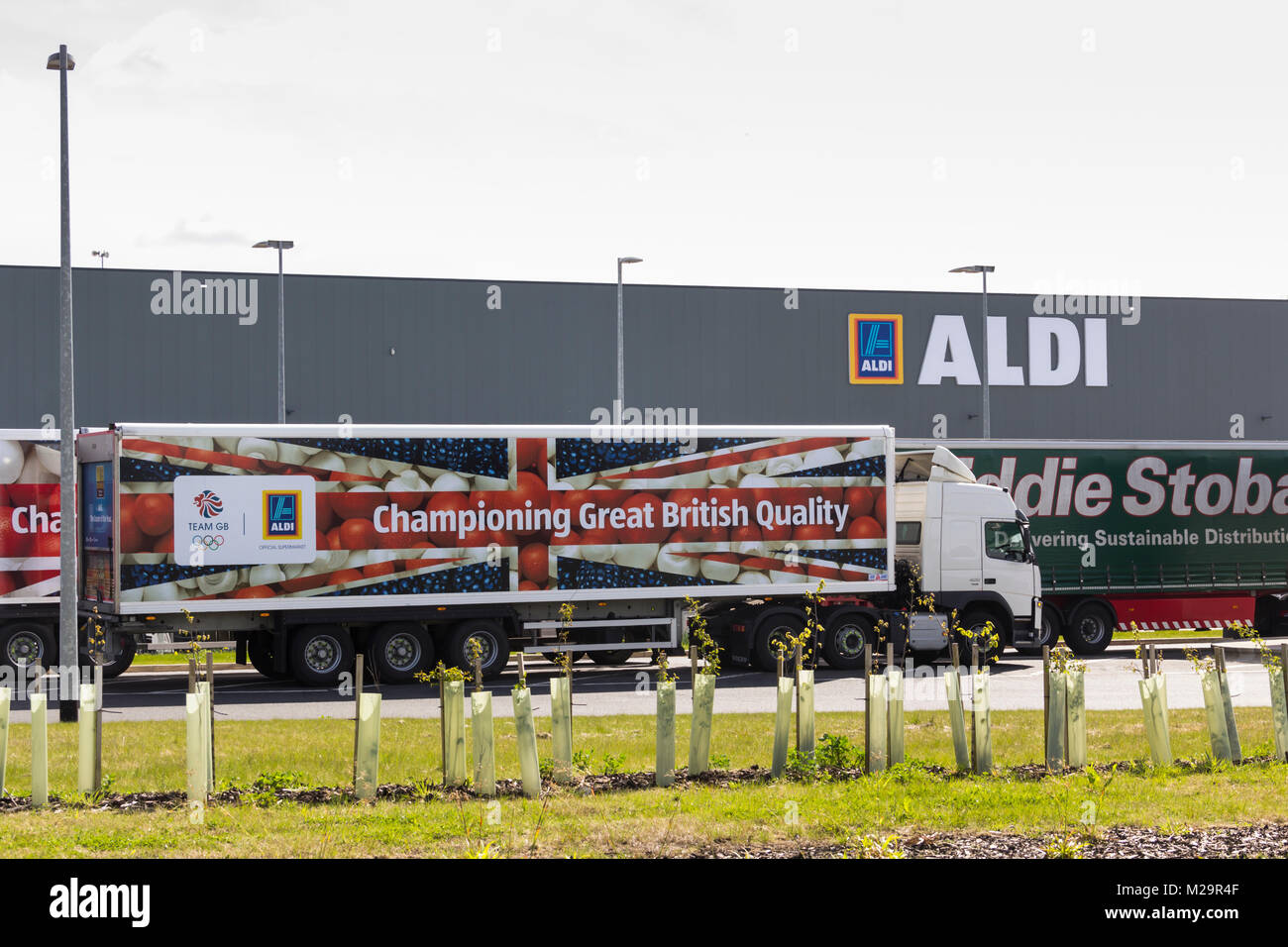 Aldi and Eddie Stobart branded articulated lorries outside the new Aldi Distribution warehouse at Logistics North, - Stock Image