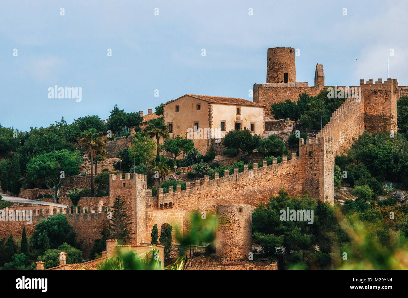 Capdepera castle on green hill in Mallorca island, Spain. Beautiful landscape with medieval architecture in Majorca - Stock Image