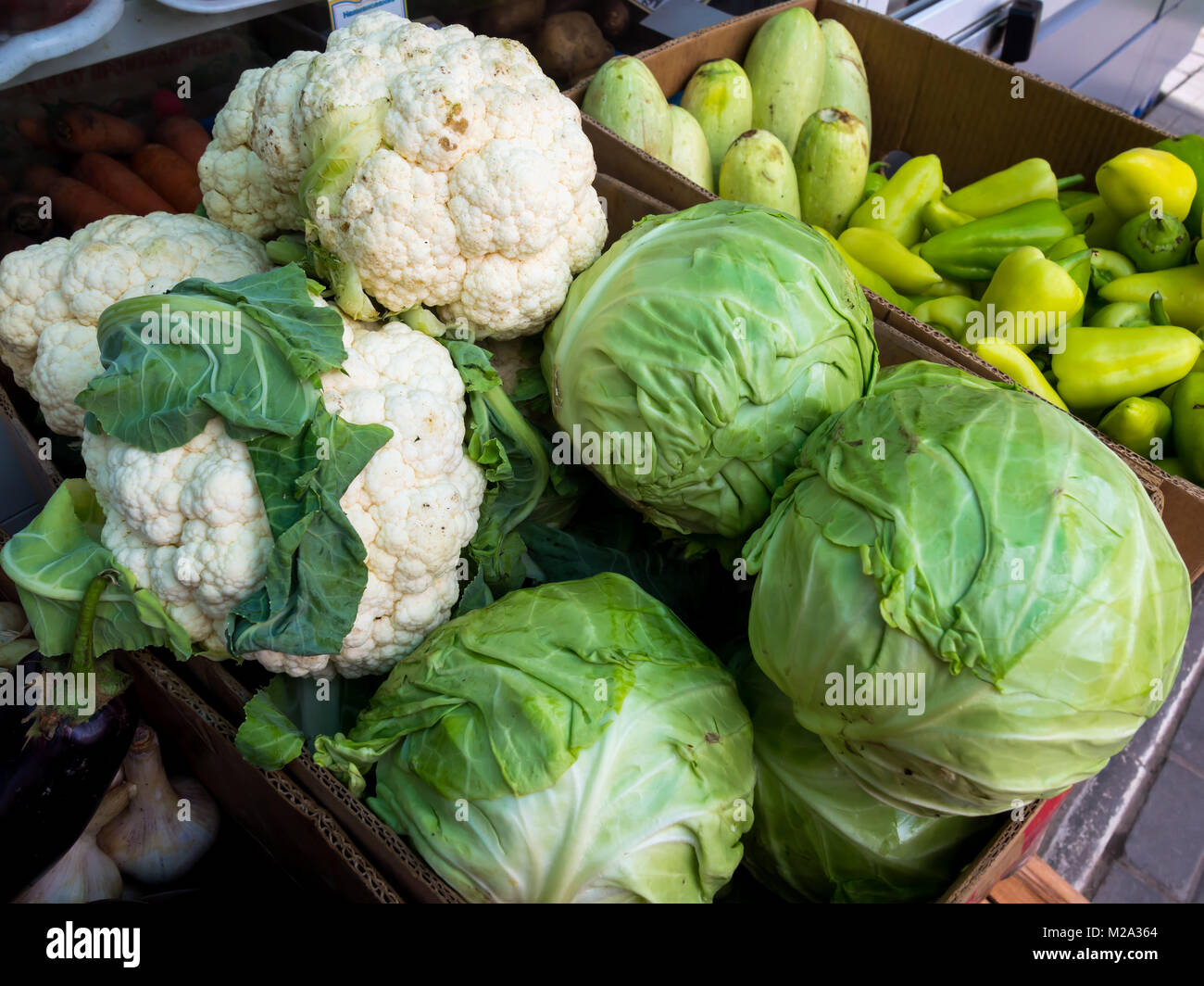 Cardboard boxes with vegetables on a street point of sale - Stock Image