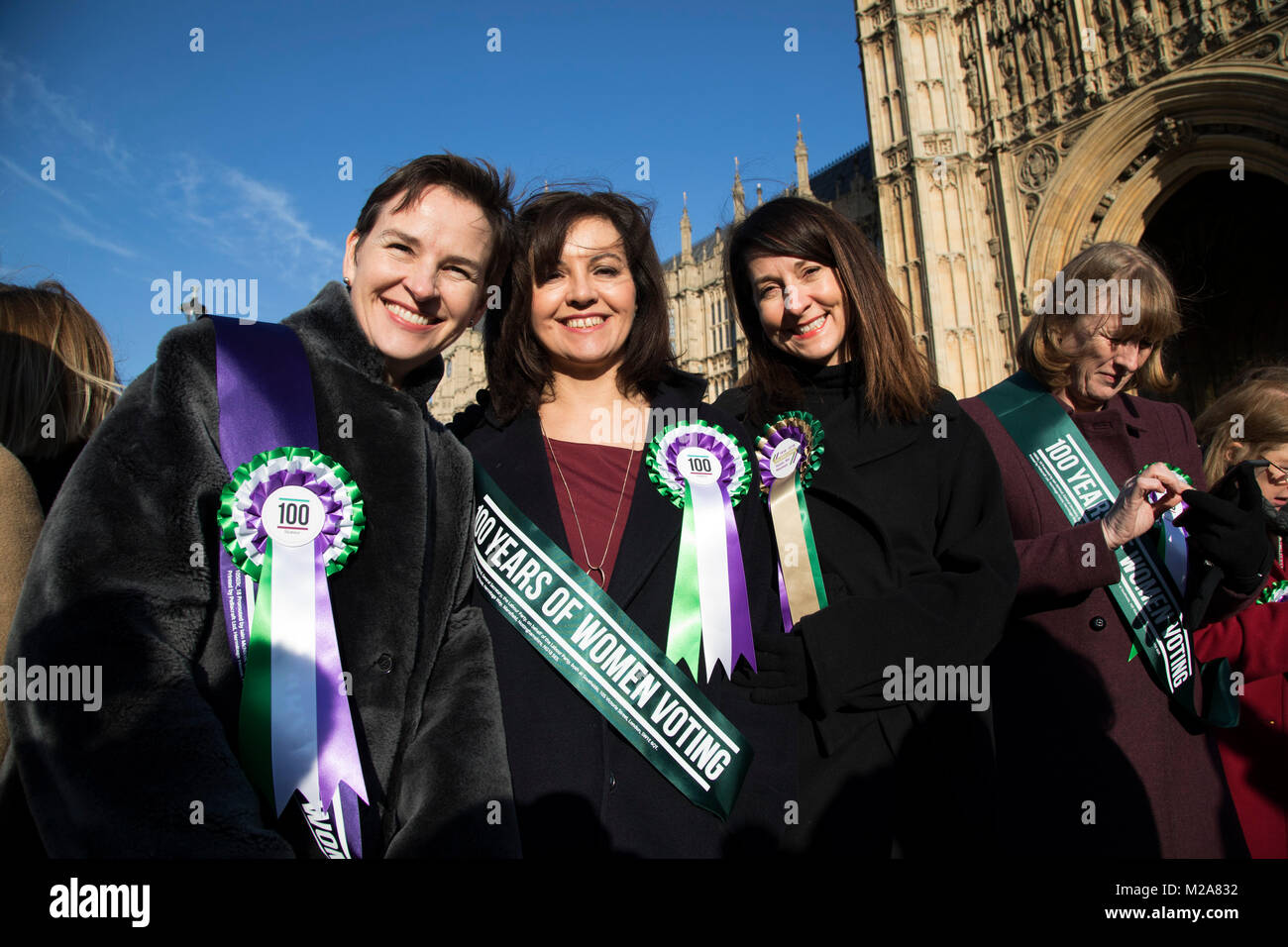 Women MPs from the Labour Party gather outside the Houses of Parliament to celebrate the 100th anniversary of the - Stock Image