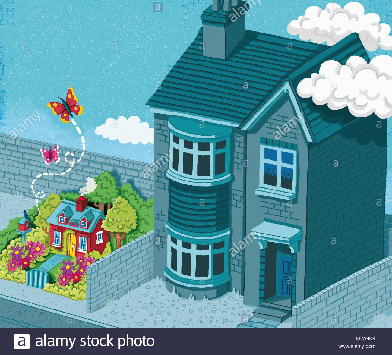 Small cottage in colourful garden next to large gray house - Stock Image