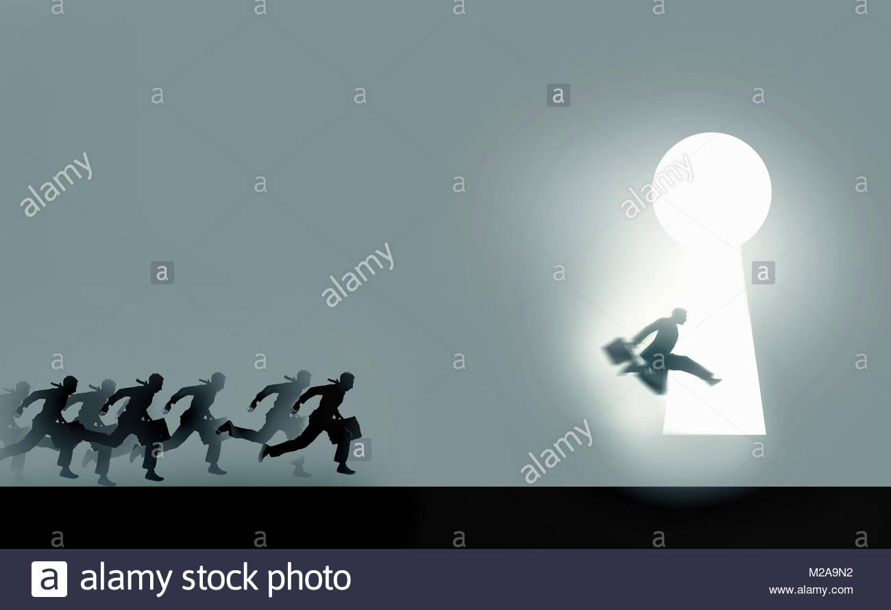 Businessmen running in race to enter illuminated keyhole - Stock Image