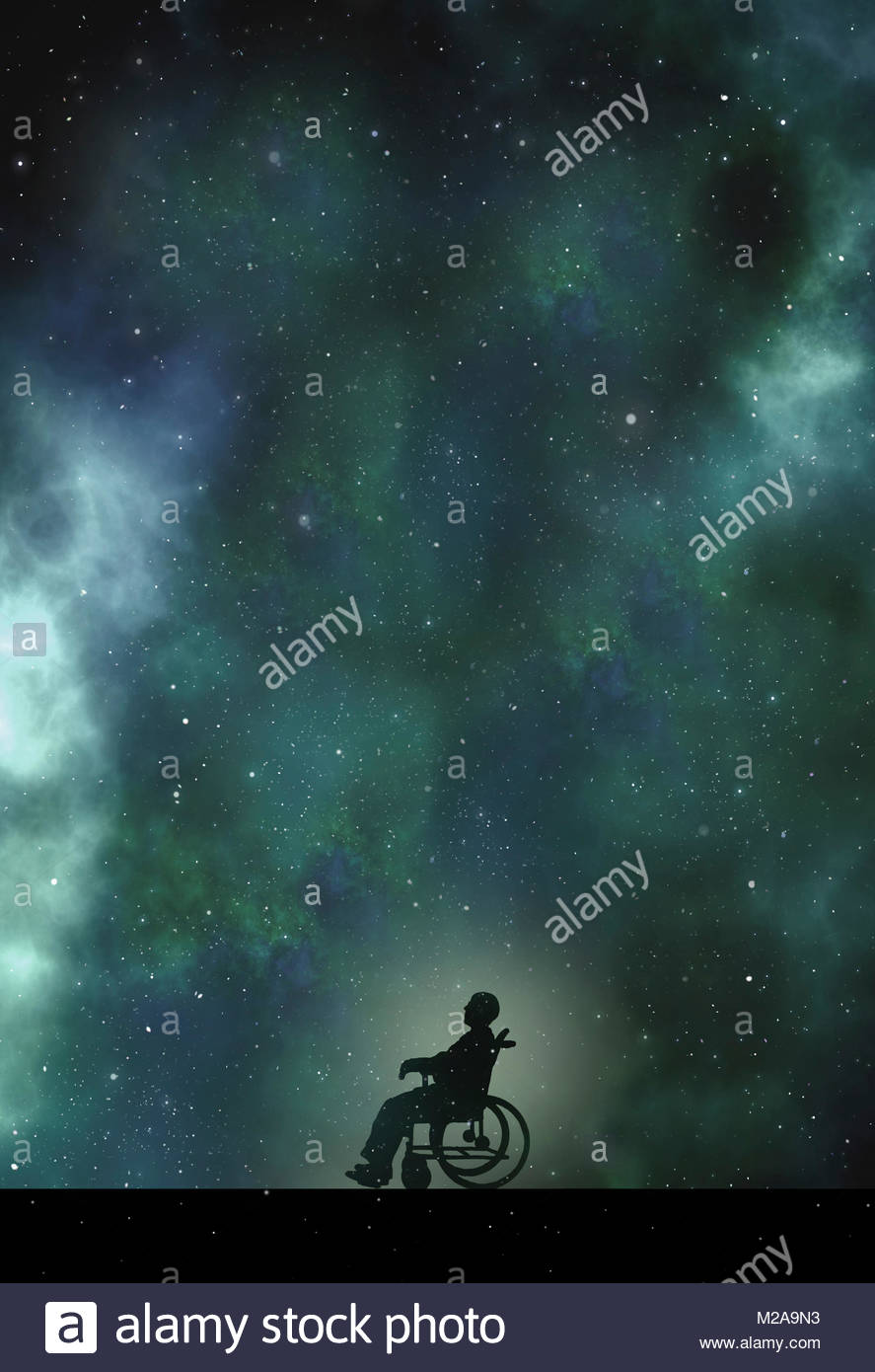 Disabled man in wheelchair looking up at night sky - Stock Image