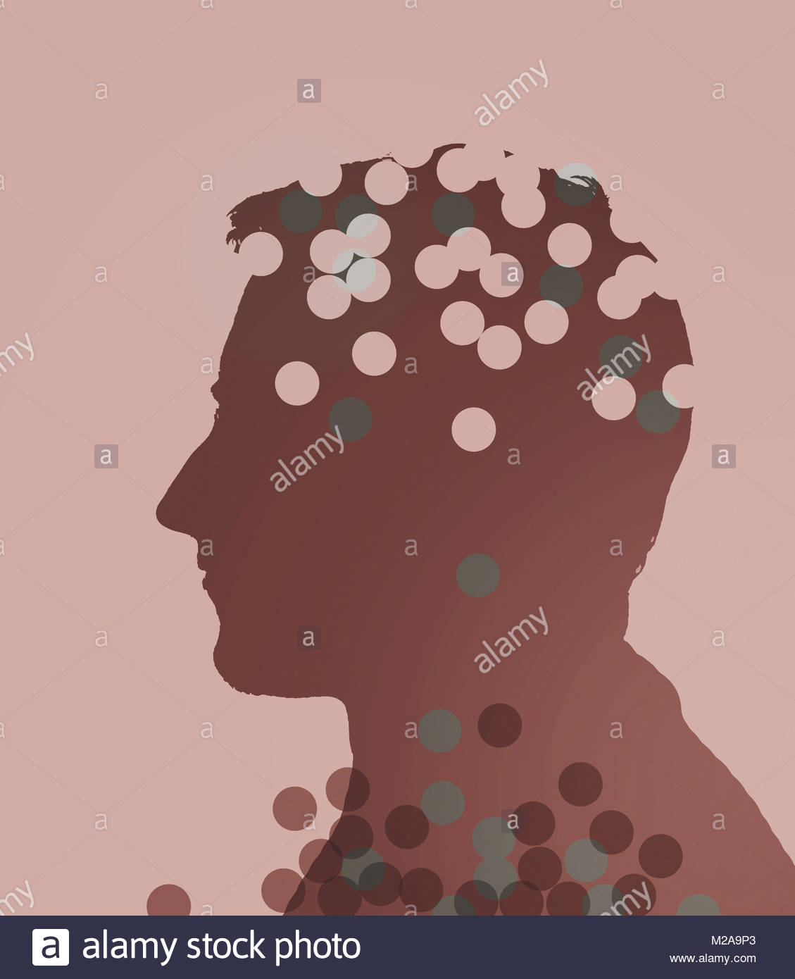 Circles falling from profile of man's head leaving holes - Stock Image