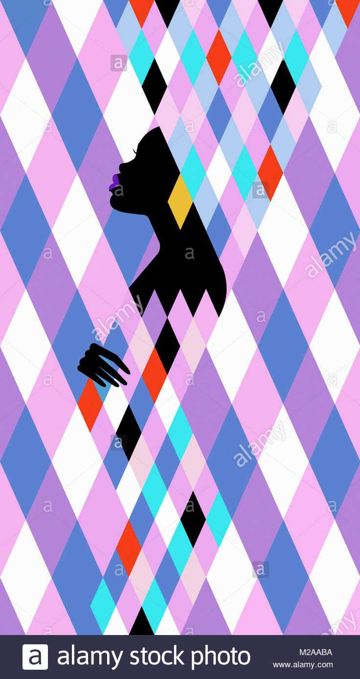 Woman emerging from geometric multicolored diamond shape pattern Stock Photo