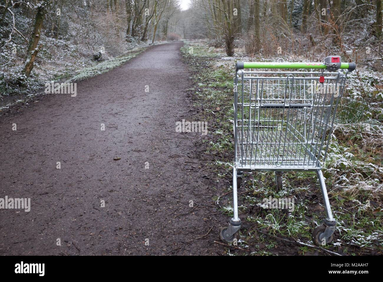 A shopping trolley left abandoned on the Sett Valley Trail about one mile/two kilometres from the Co-op, from where - Stock Image