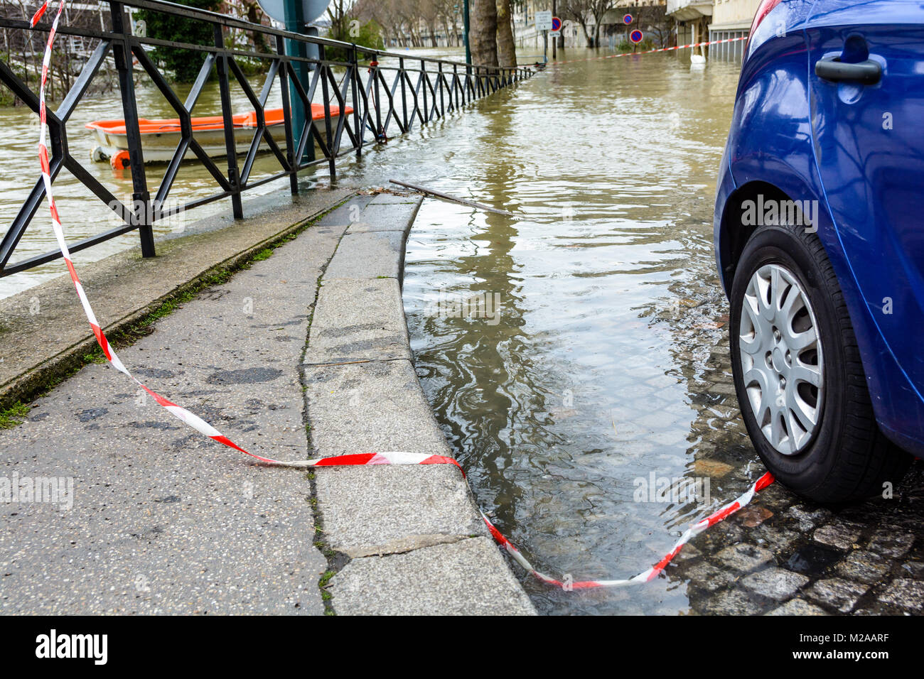 During the winter flood of the Seine in Paris, in January 2018, the level of the floodwater reaches the rear wheels - Stock Image