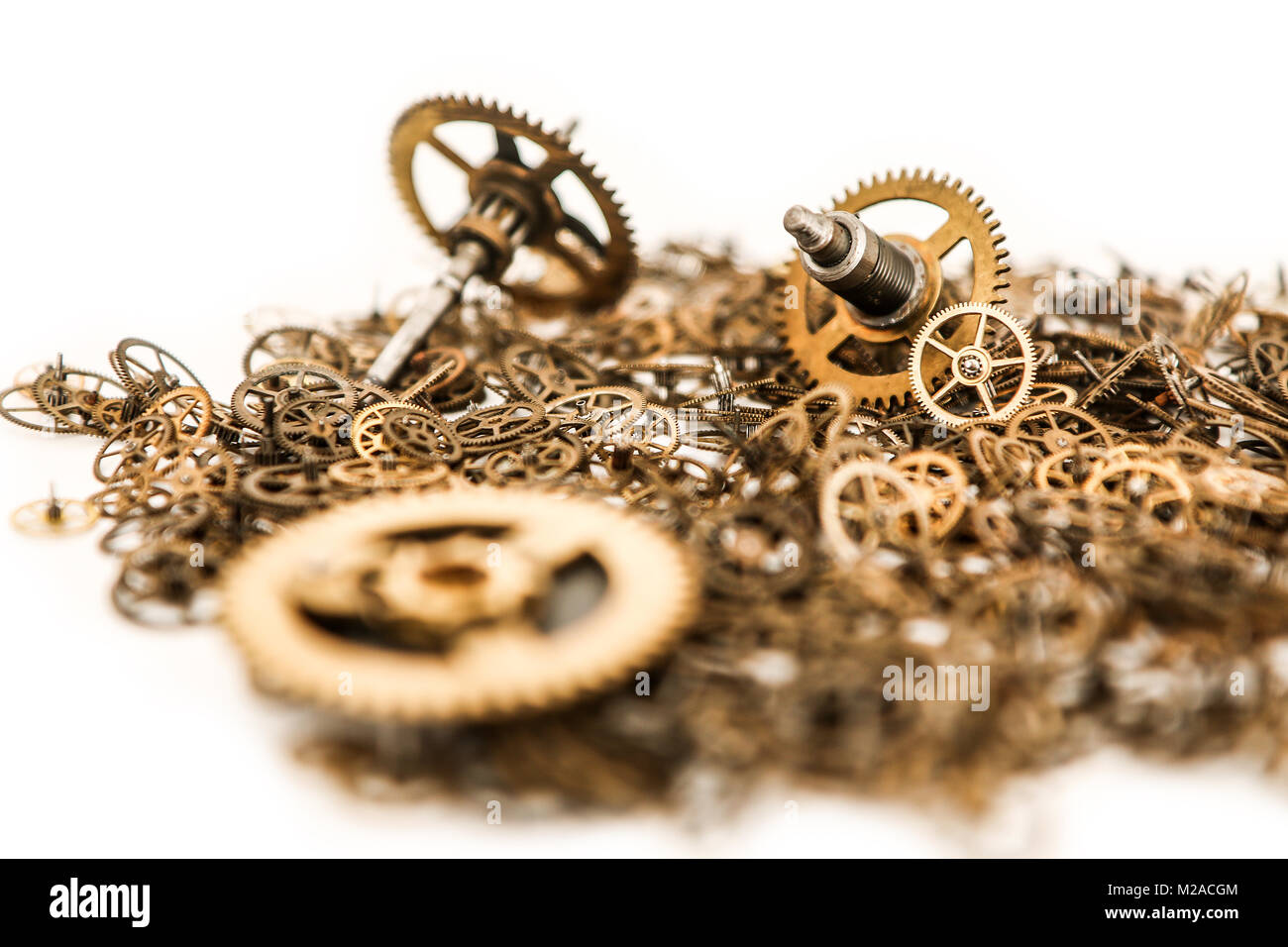 A picture of a small batch of cogwheels on a white background. - Stock Image