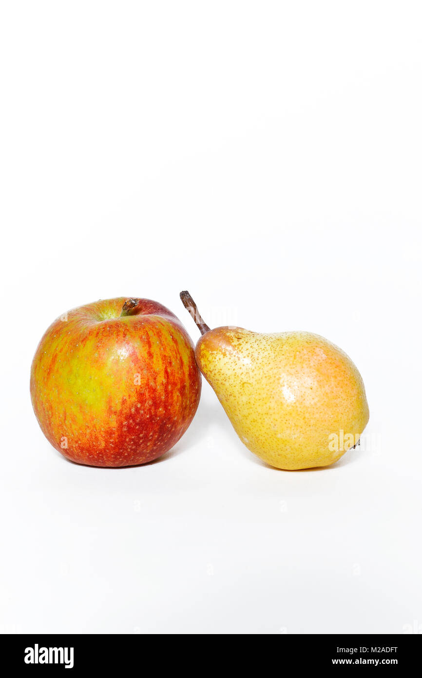 Apple and pear on white background - Stock Image