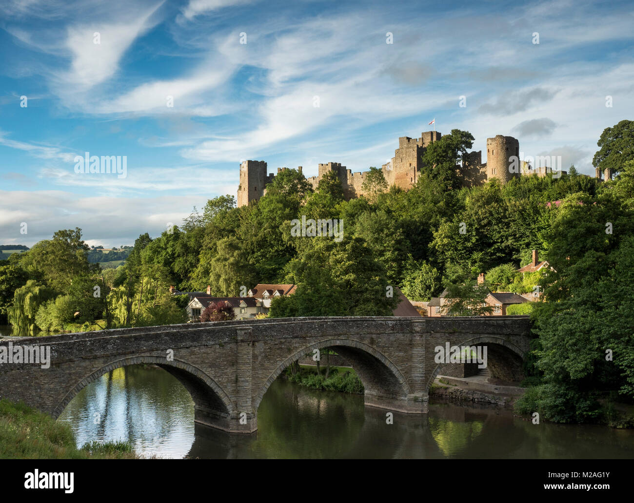 Ludlow castle bathed in the last light of a summers evening. - Stock Image