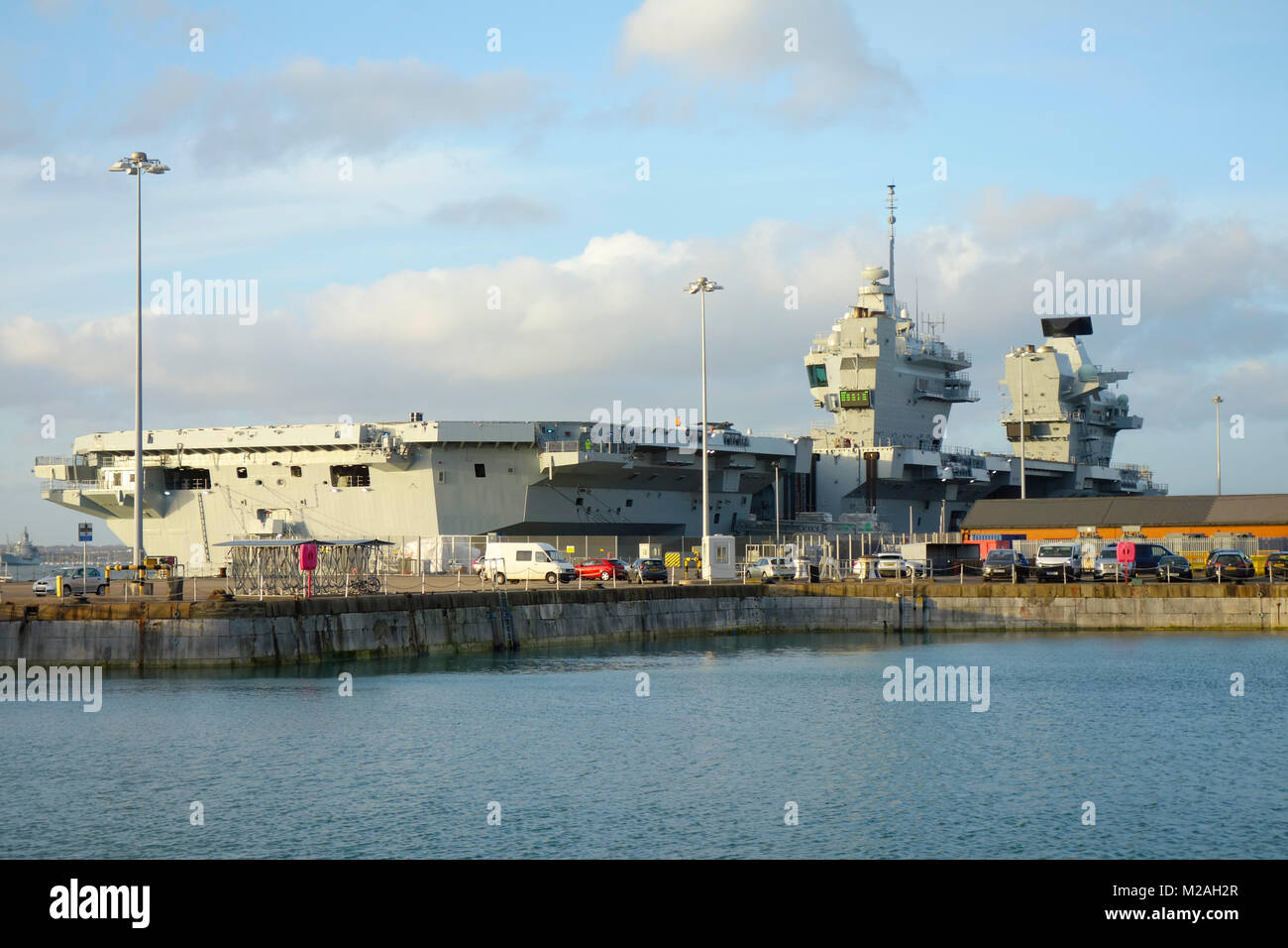 HMS Queen Elizabeth - Aircraft Carrier docked in HM Naval Base Portsmouth, Hampshire, United Kingdom - Stock Image