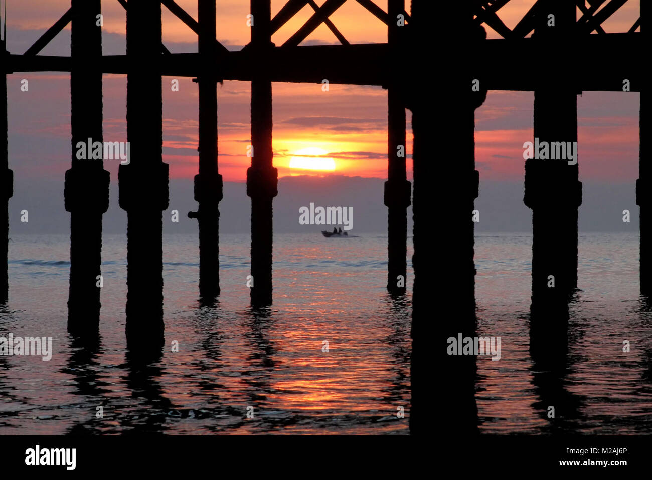 Sunset under Blackpool Pier - Stock Image