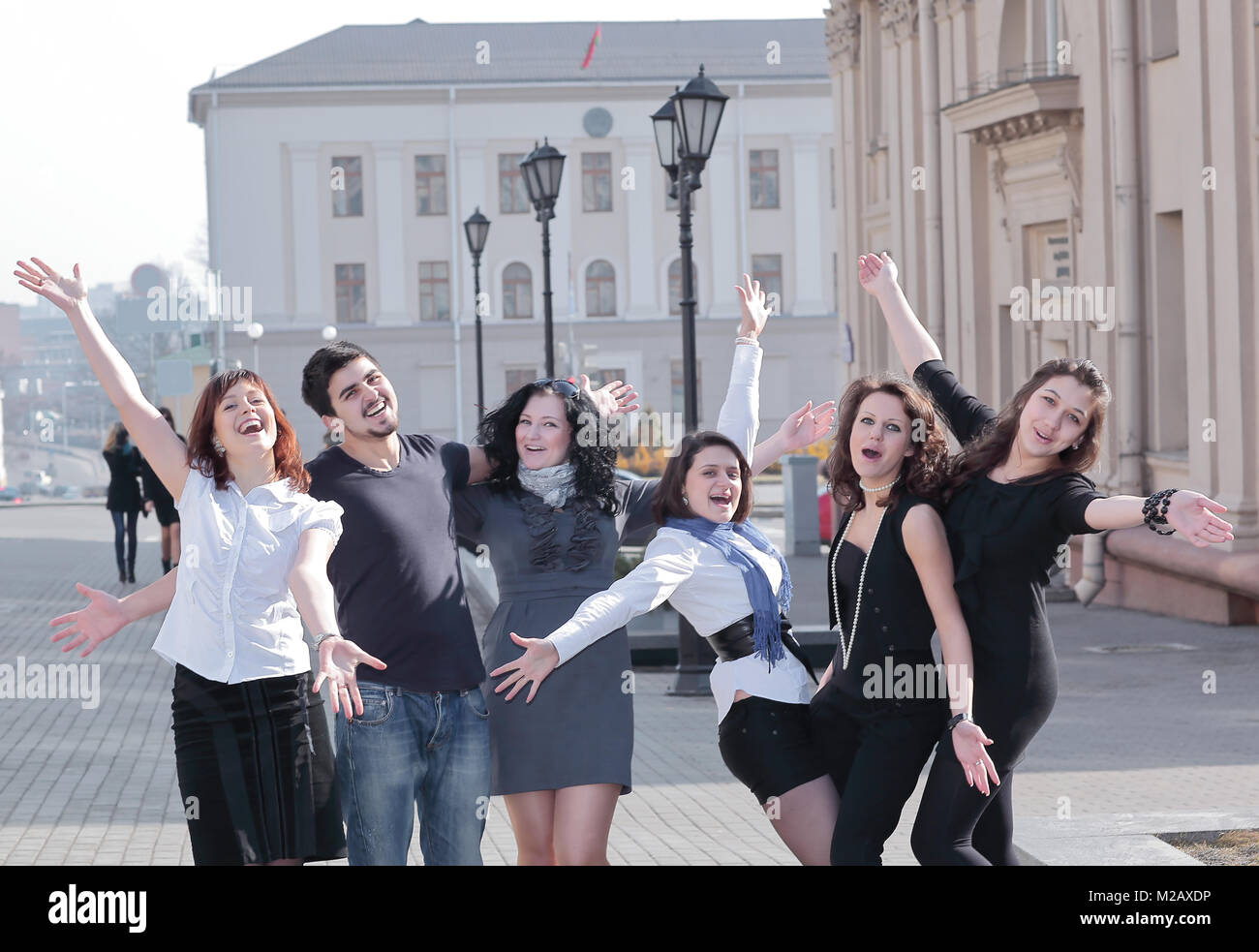 group of happy students standing on the street . - Stock Image