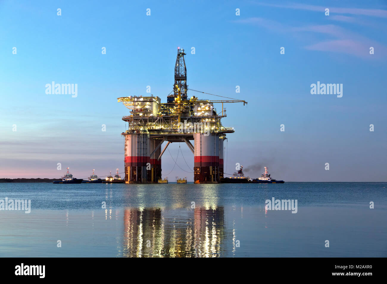 'Big Foot'  Chevron's Deep Ocean Platform departs Kiewit Industries at dawn, oil & natural gas drill - Stock Image