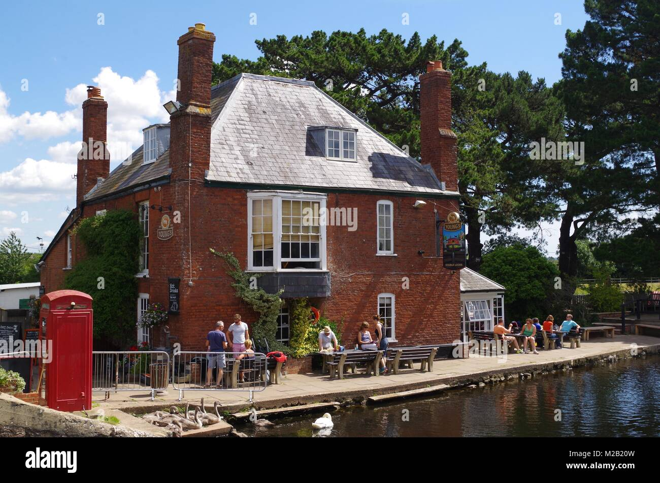 Double Locks 18th Century Lock Keepers House and Inn Pub on the Exeter Ship Canal in High Summer. Devon, UK. 2015. - Stock Image