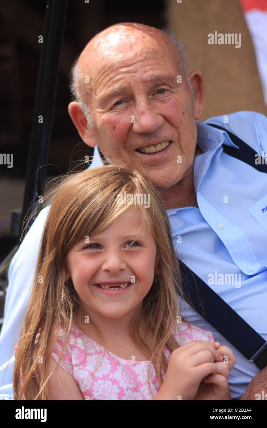 Sir Stirling Moss OBE poses for a photograph with a young fan at Shelsley Walsh hill climb in 2014 - Stock Image