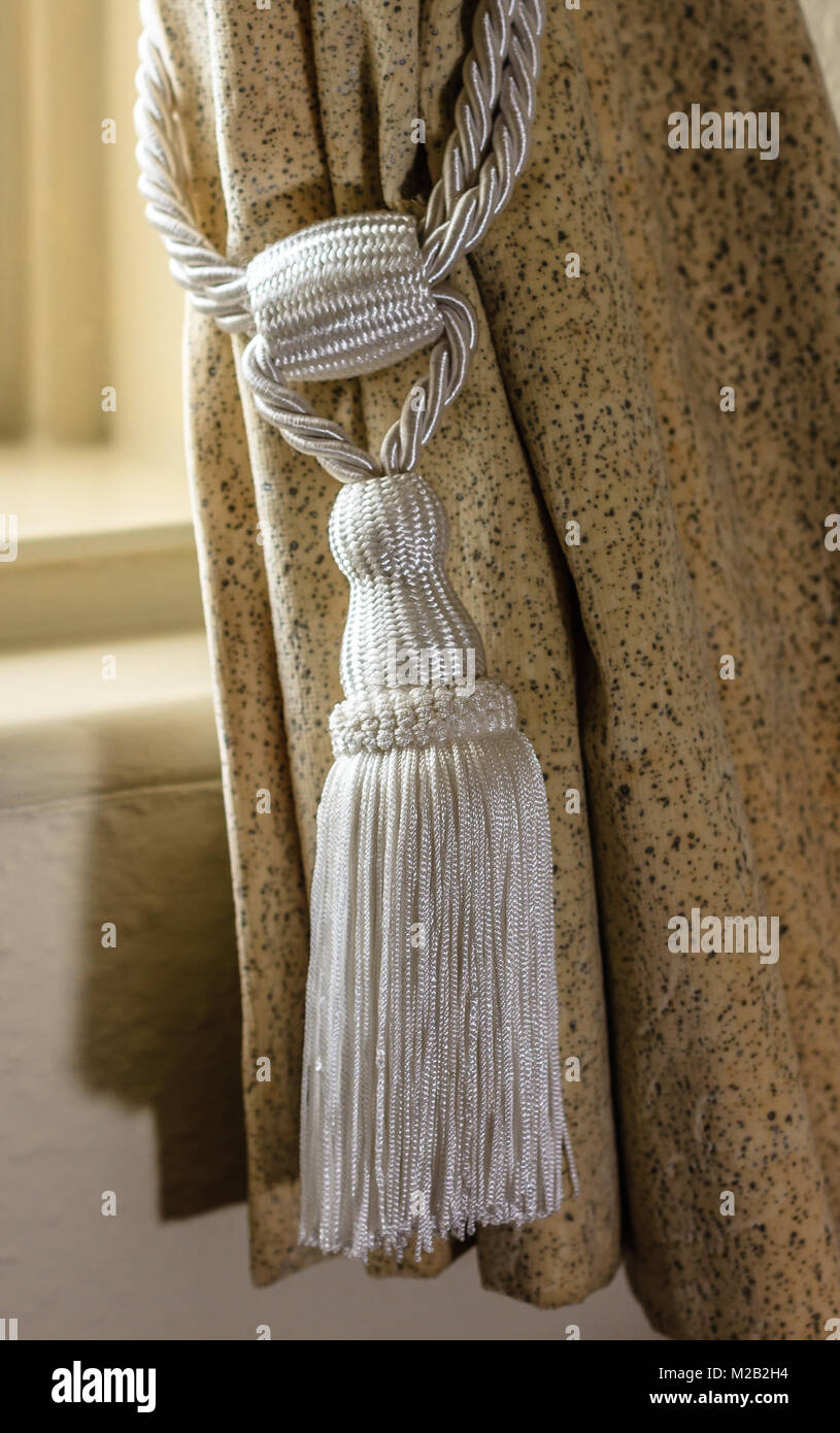 Tassel on a curtain to hold it back when open - Stock Image