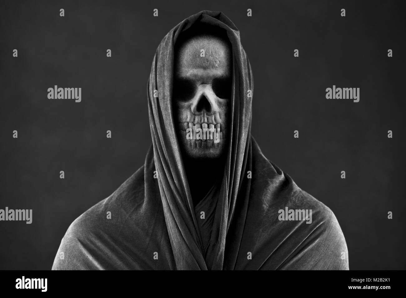 Grim reaper in the dark - Stock Image