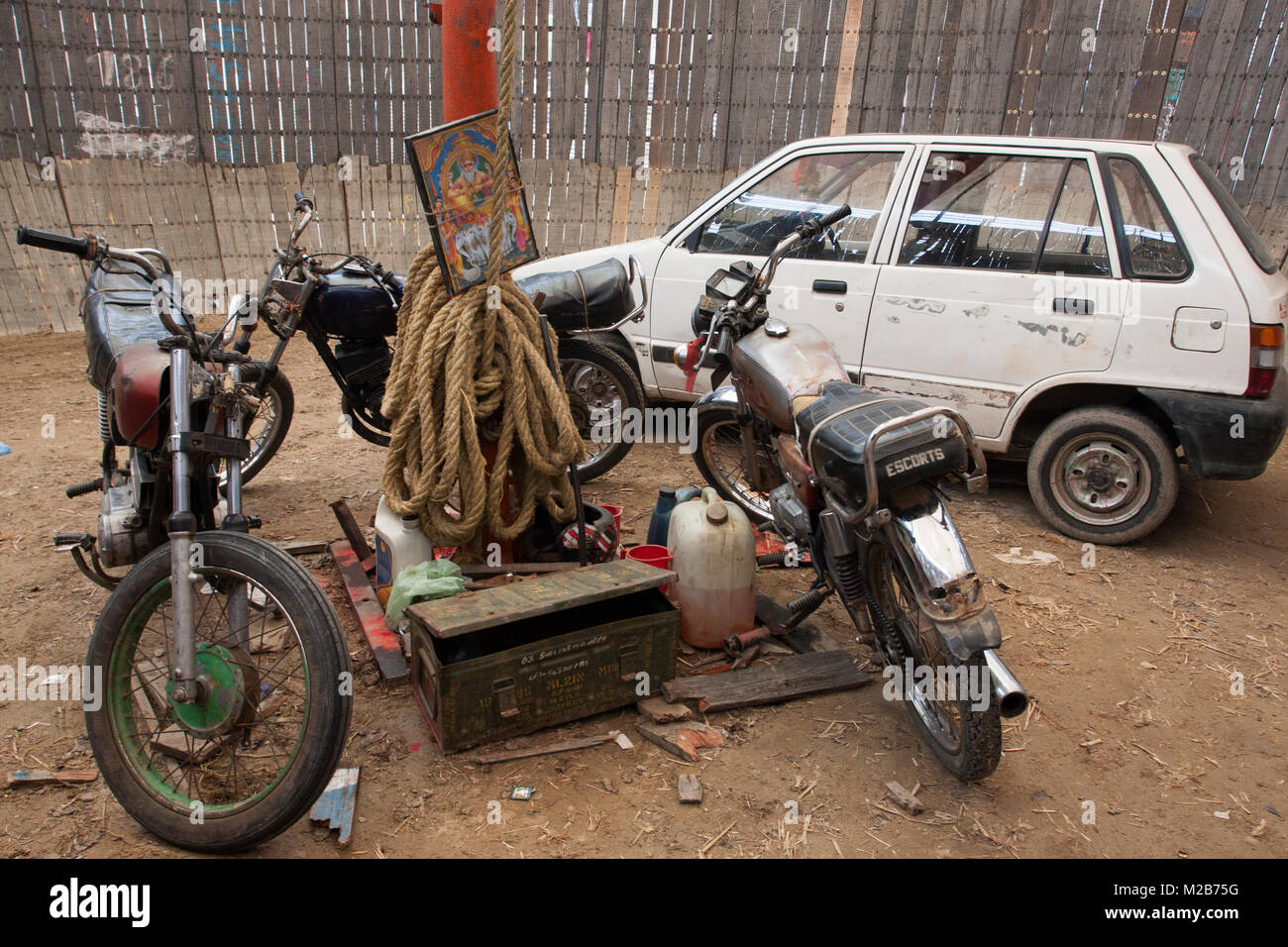 Bikes and a car in a circus arena called death of bowl in Nepal. - Stock Image