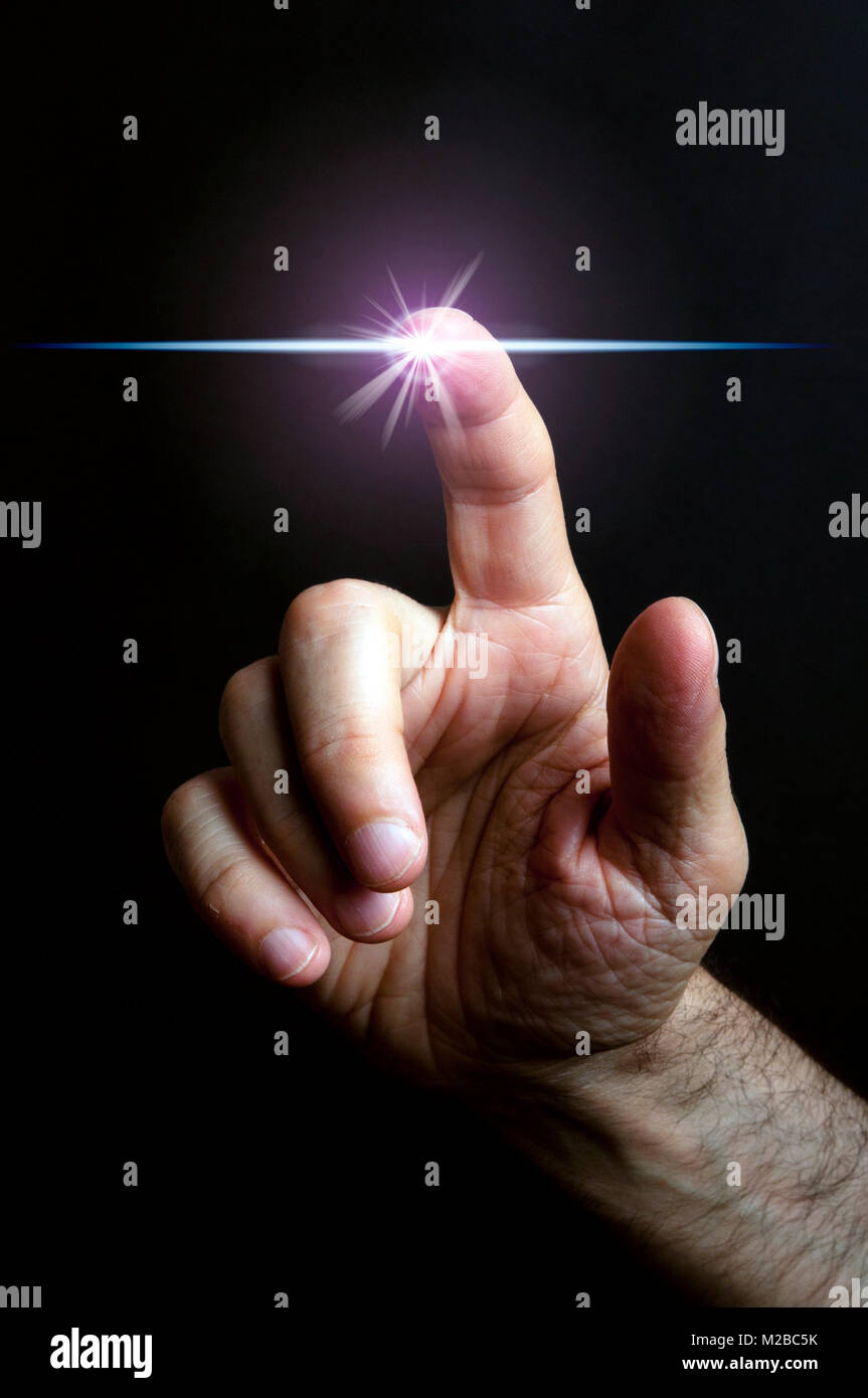 male hand with the finger touching a spot and crating a light flare - Stock Image