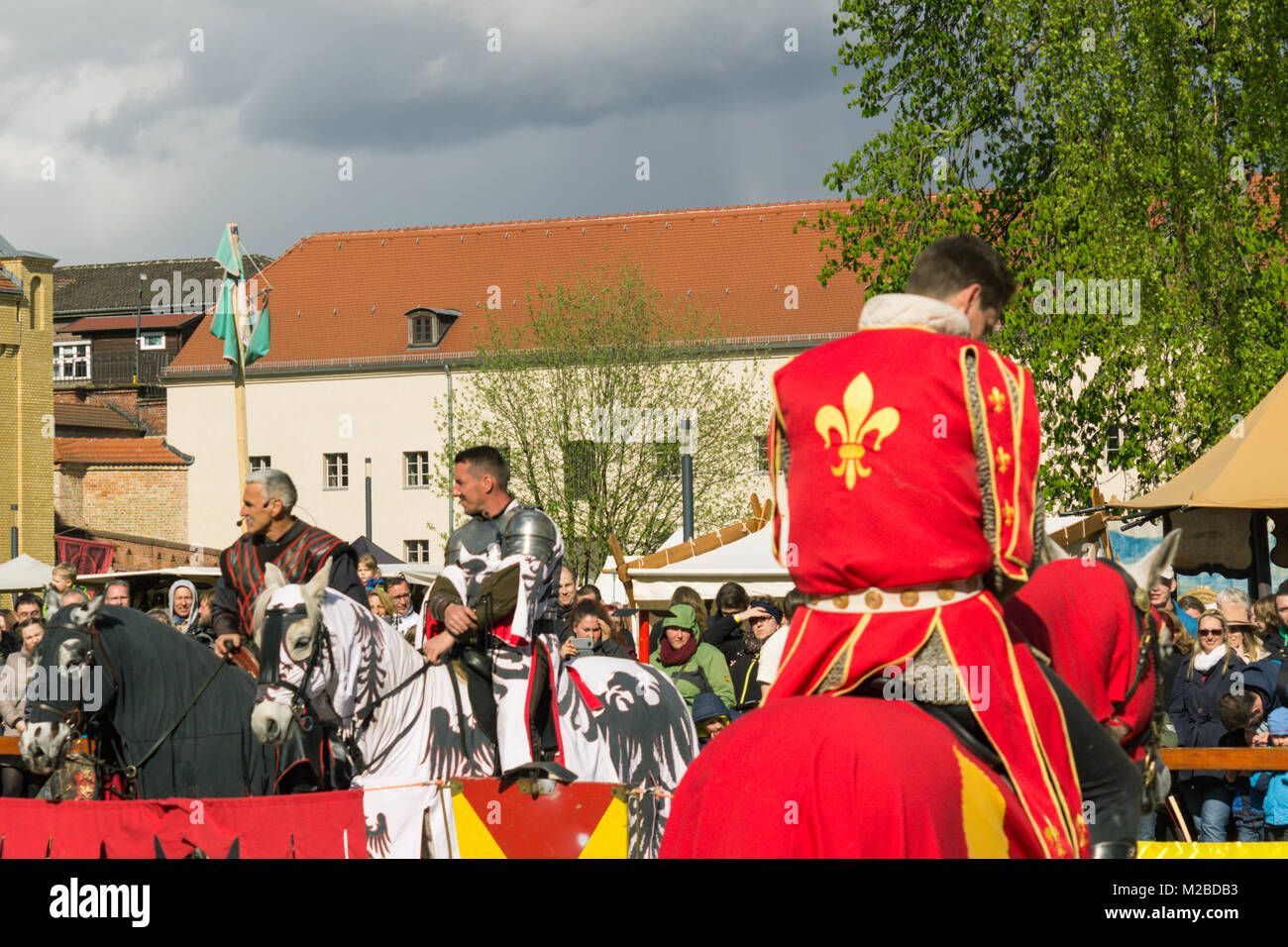 Actors playing horse soldier in a competition during a medieval festival with lots of audience in Germany - Stock Image