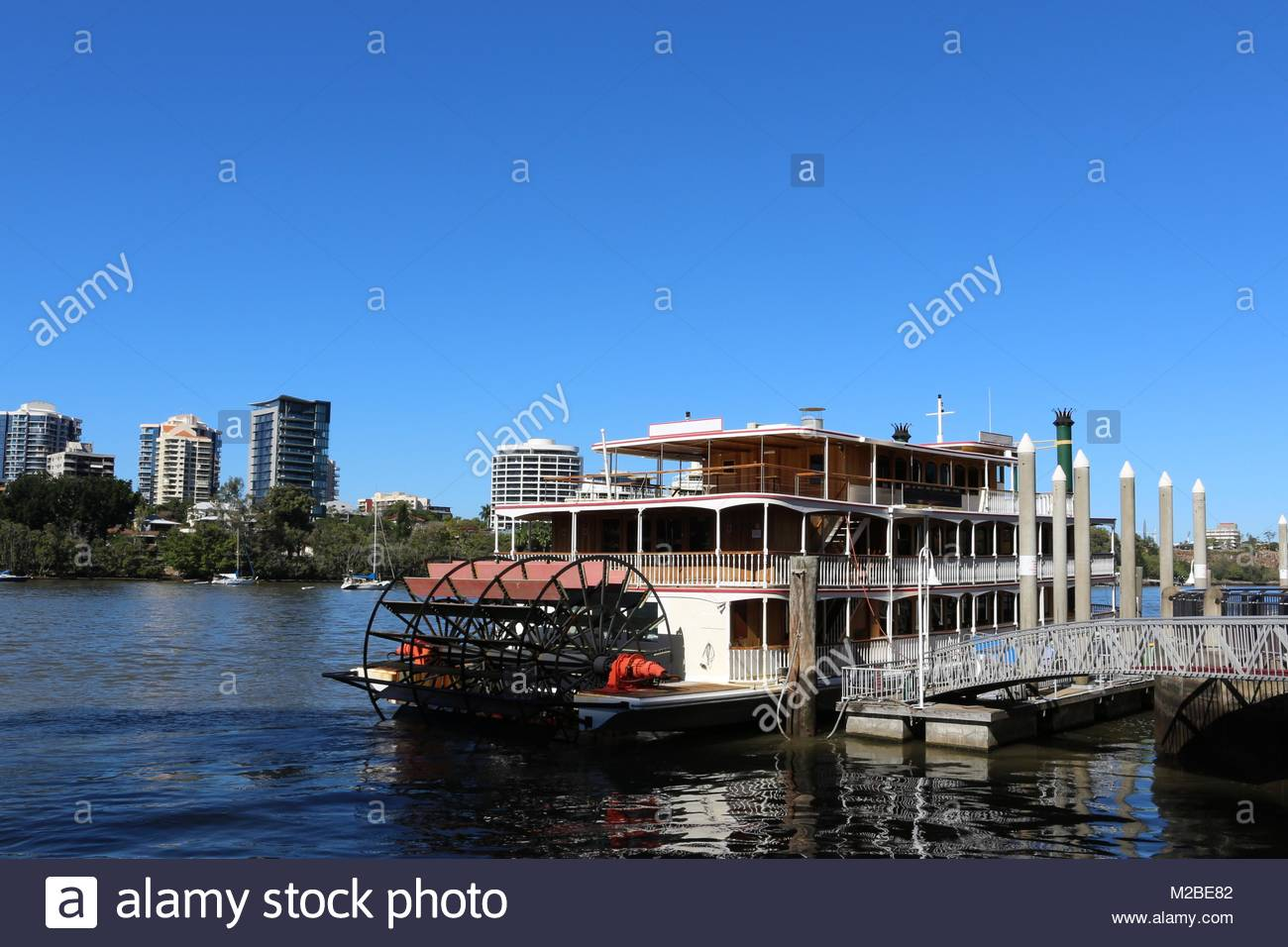 Paddle wheel boat cruises Brisbane river in Australia - Stock Image