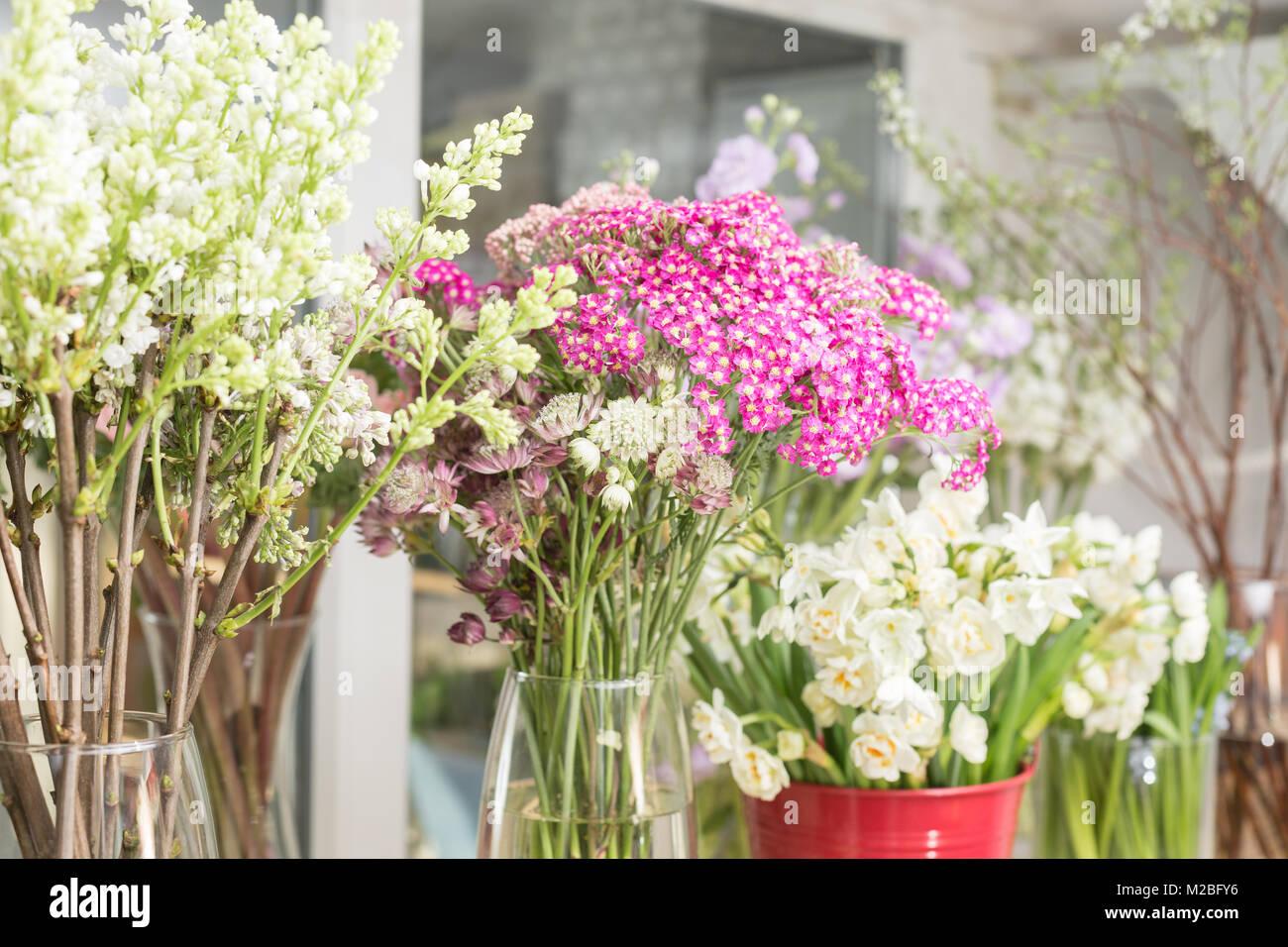 Flower shop concept. Different varieties fresh spring flowers in ...