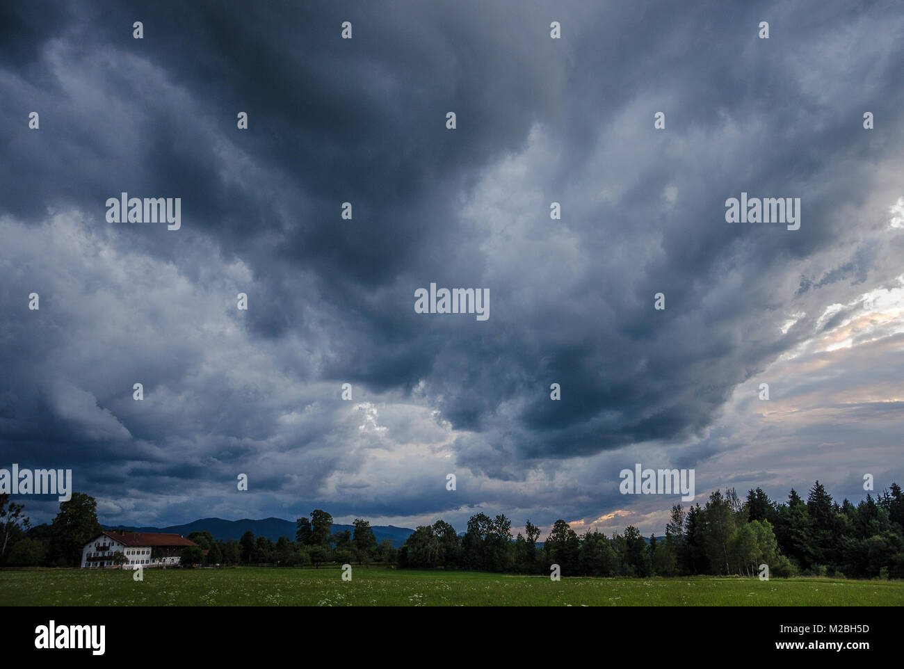A thunderstorm, also known as an electrical storm, lightning storm, or thundershower, is a storm characterized by - Stock Image